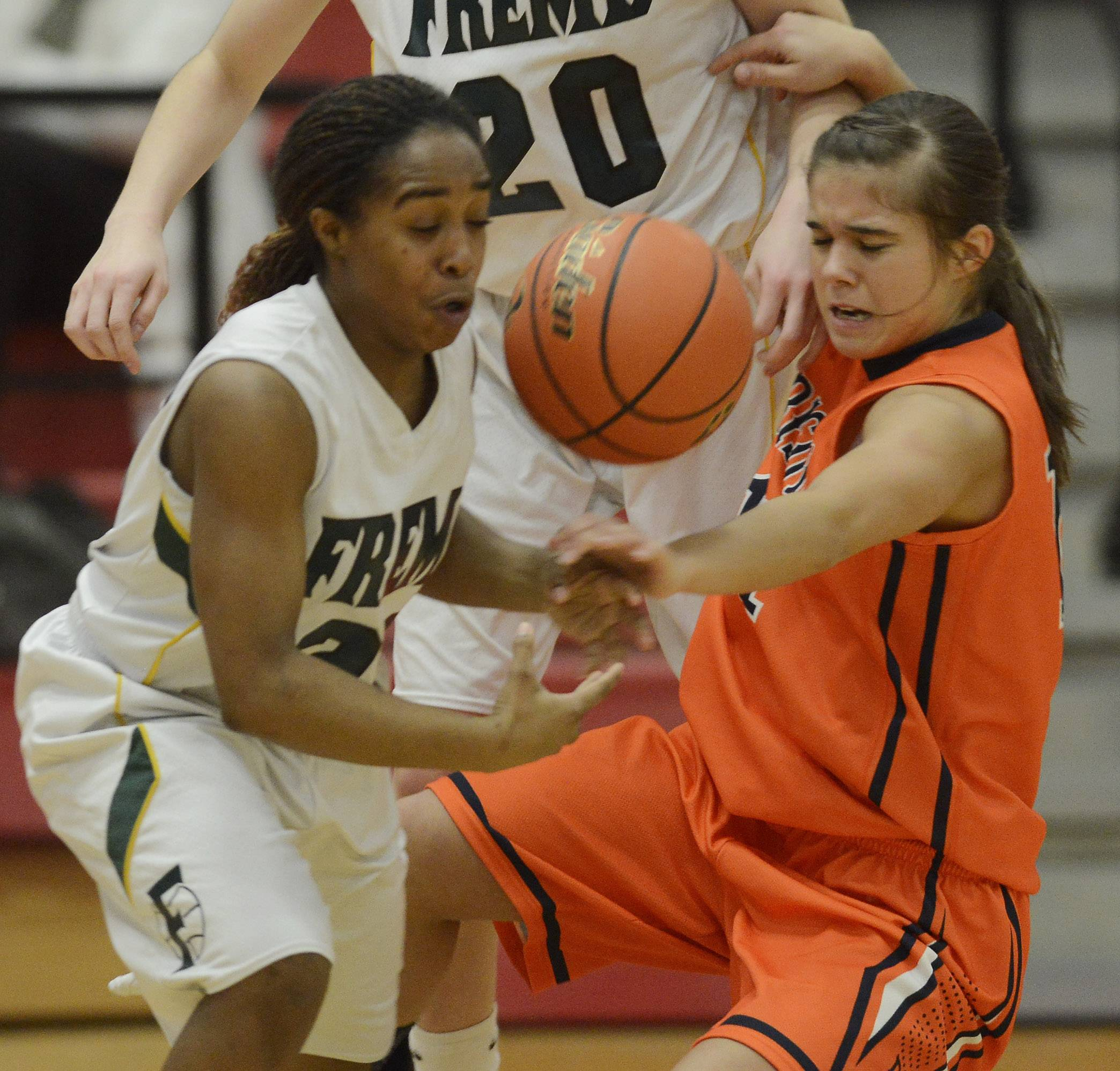 Fremd's Brianna Lewis, left, and Buffalo Grove's Kim Herzog try to control a loose ball.