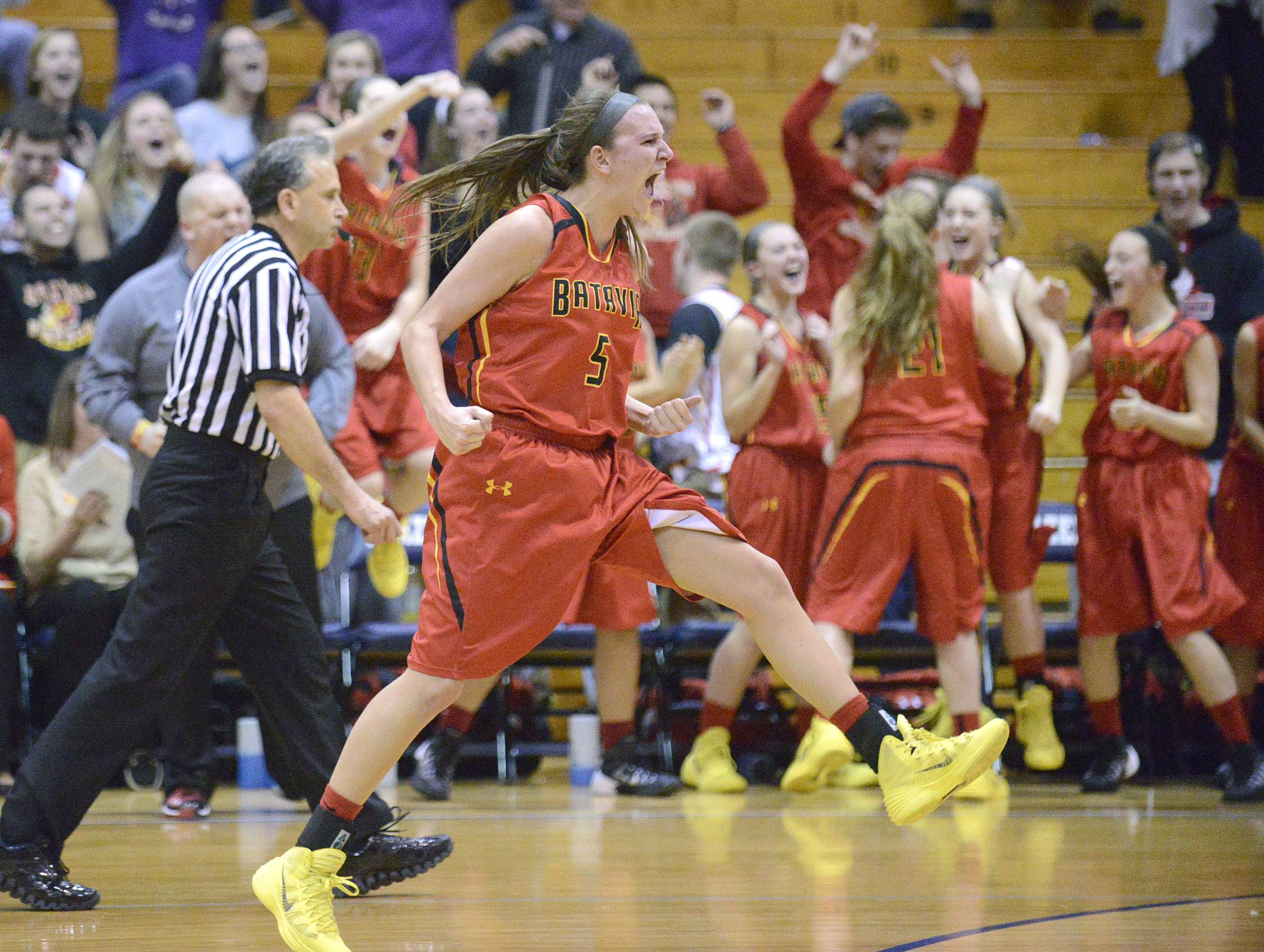 Batavia's Liza Fruendt reacts as teammate Hannah Frazier is fouled giving the Bulldogs the advantage in the final seconds of the fourth quarter .