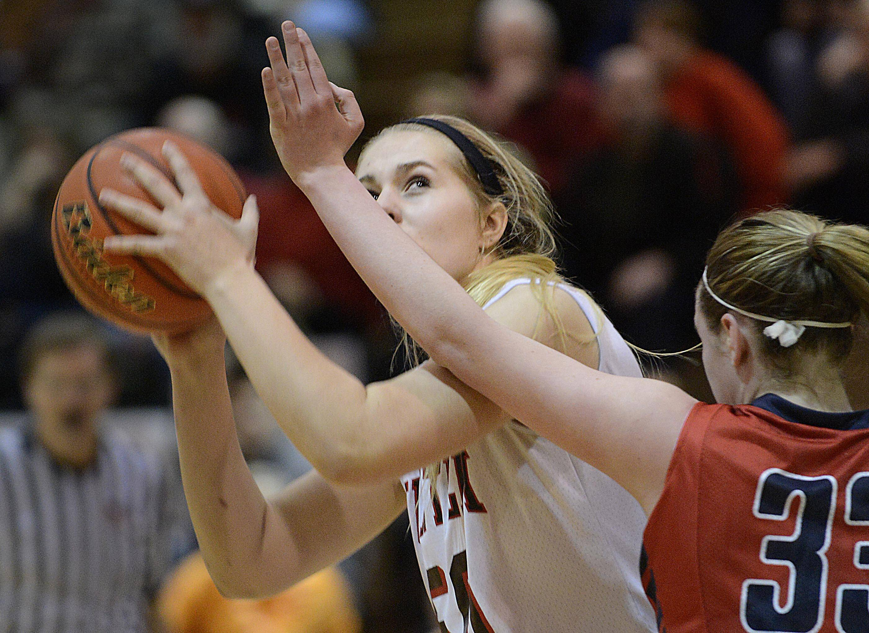 Huntley's Ali Andrews eyes the basket as she works around South Elgin's Mackie Kelleher in the Class 4A Crystal Lake South sectional game Tuesday.