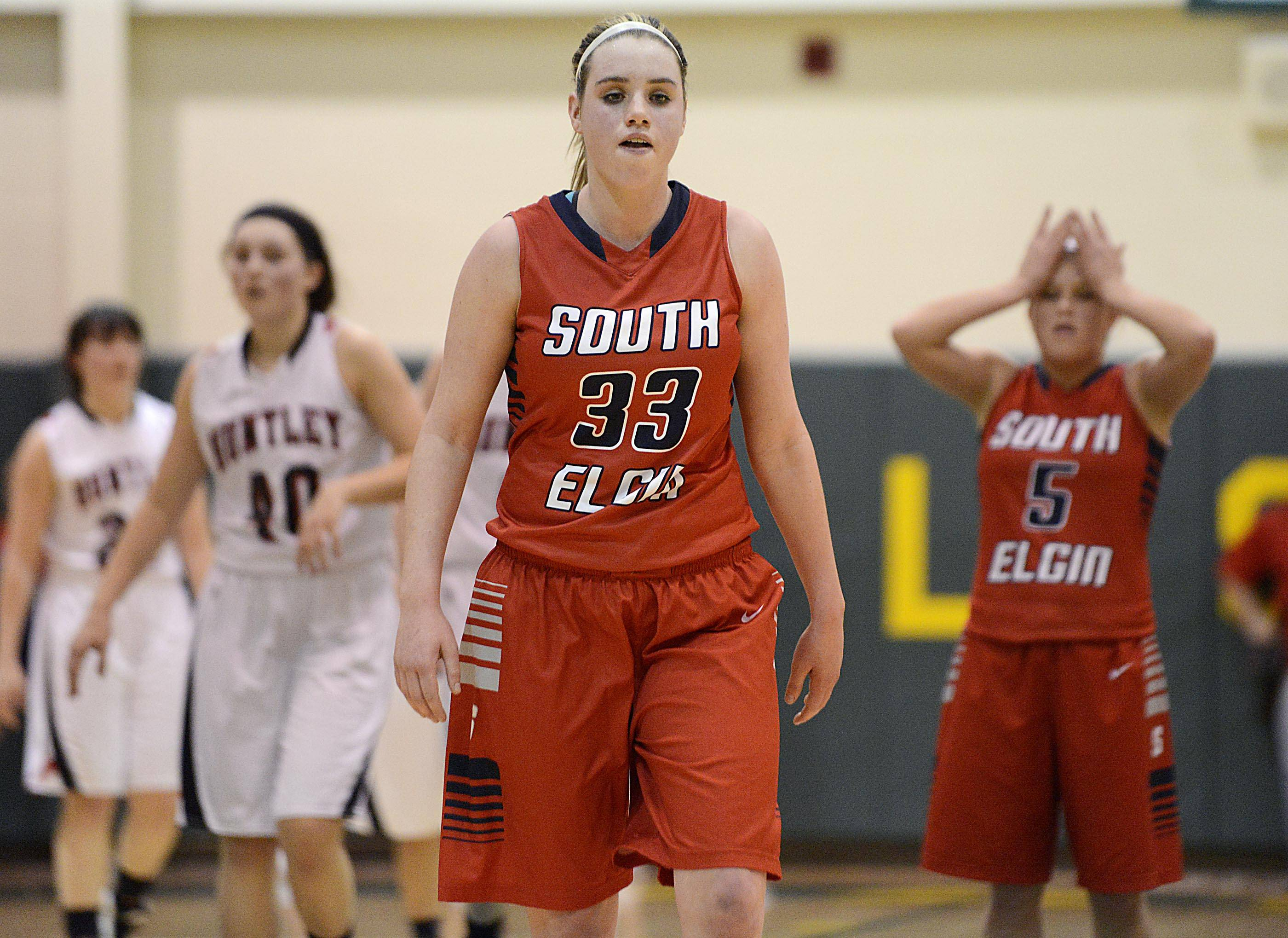 South Elgin's Mackie Kelleher and Anna Tracy, right, react late in the loss to Huntley in the Class 4A Crystal Lake South sectional game Tuesday.