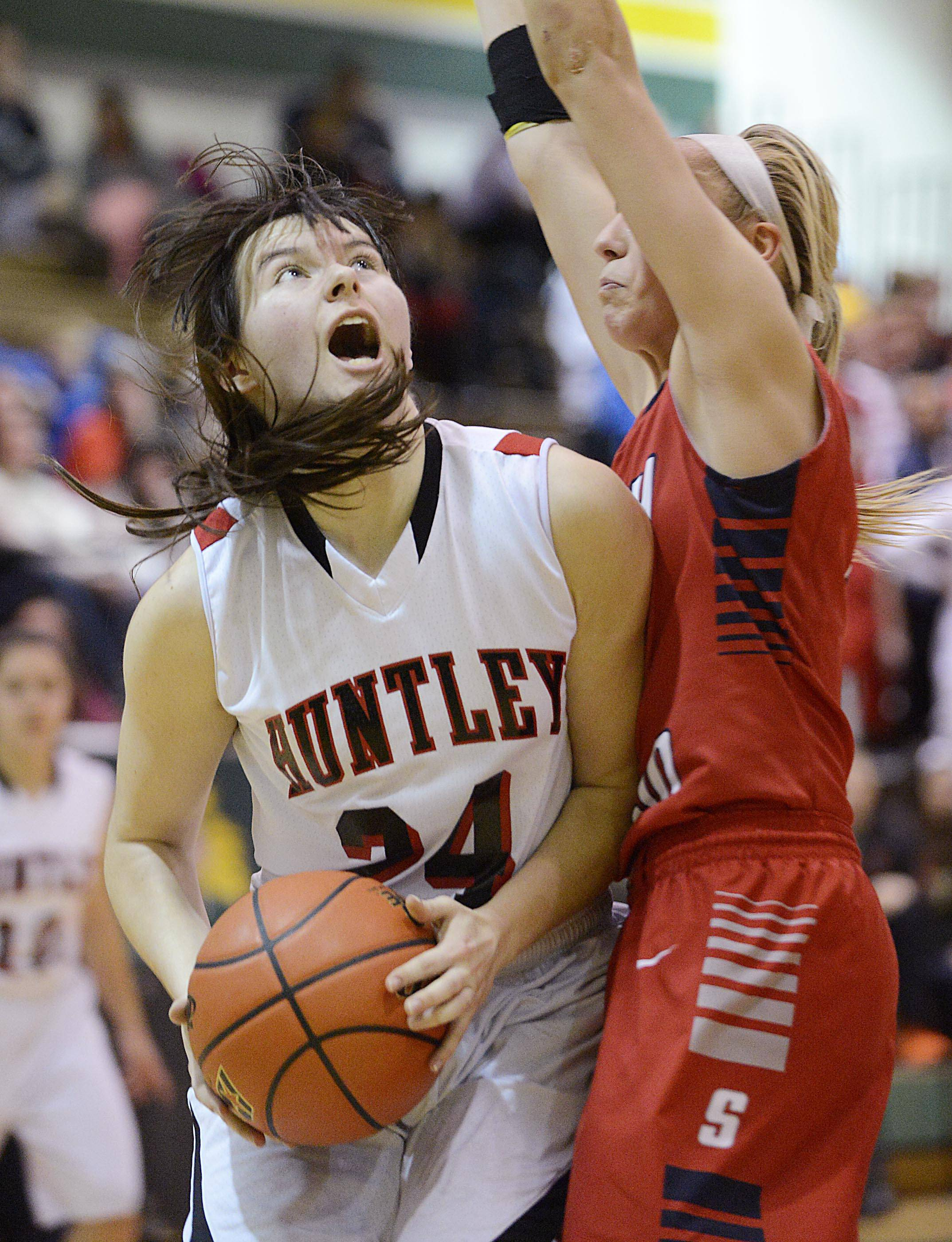 Huntley's Bethany Zornow looks for the basket as South Elgin's Savanah Uveges defends in the Class 4A Crystal Lake South sectional game Tuesday.