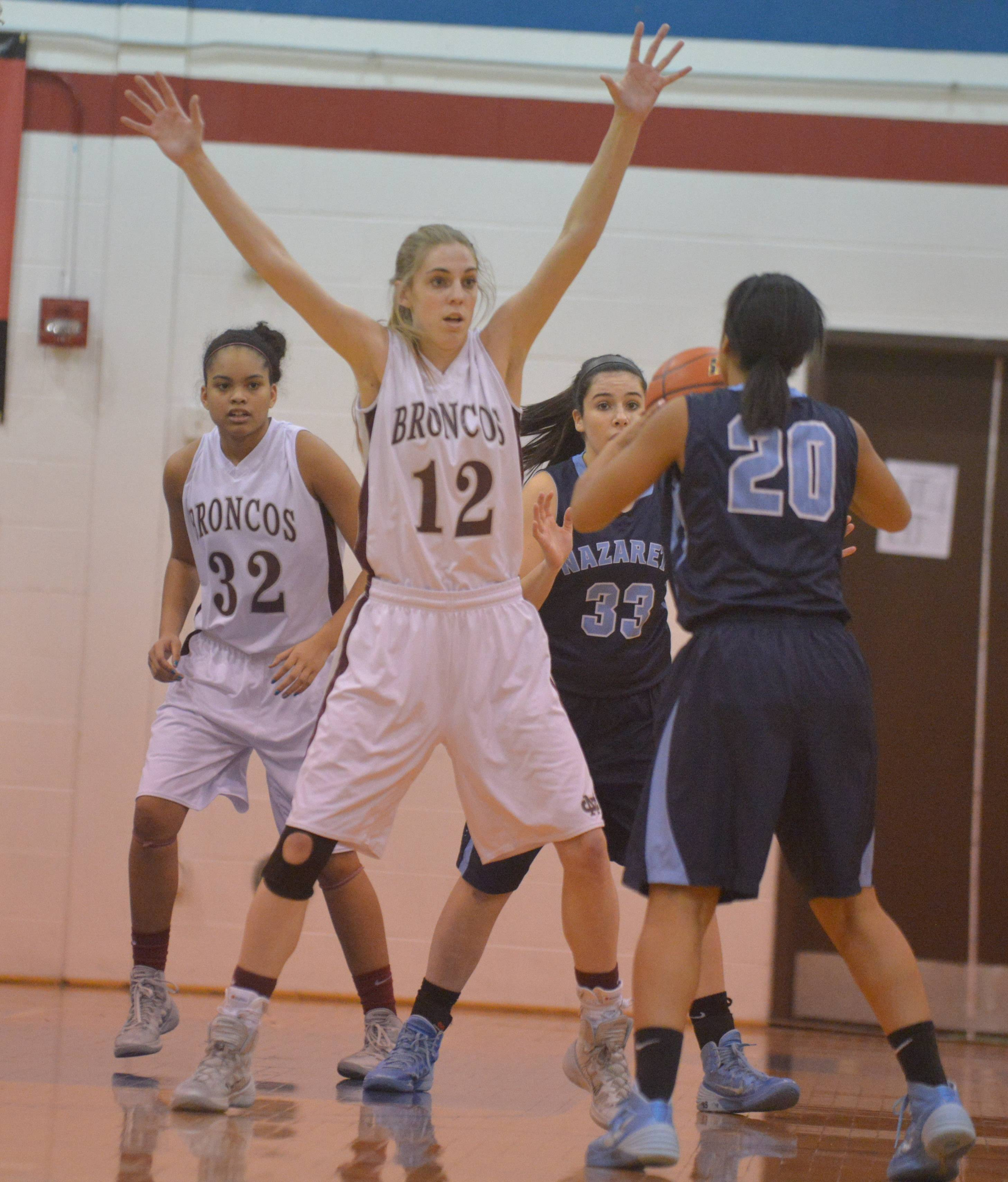 Glenbard South played Nazareth at Glenbard South Tuesday, Feb. 25 in a Class 3A girls basketball sectional semifinal game.