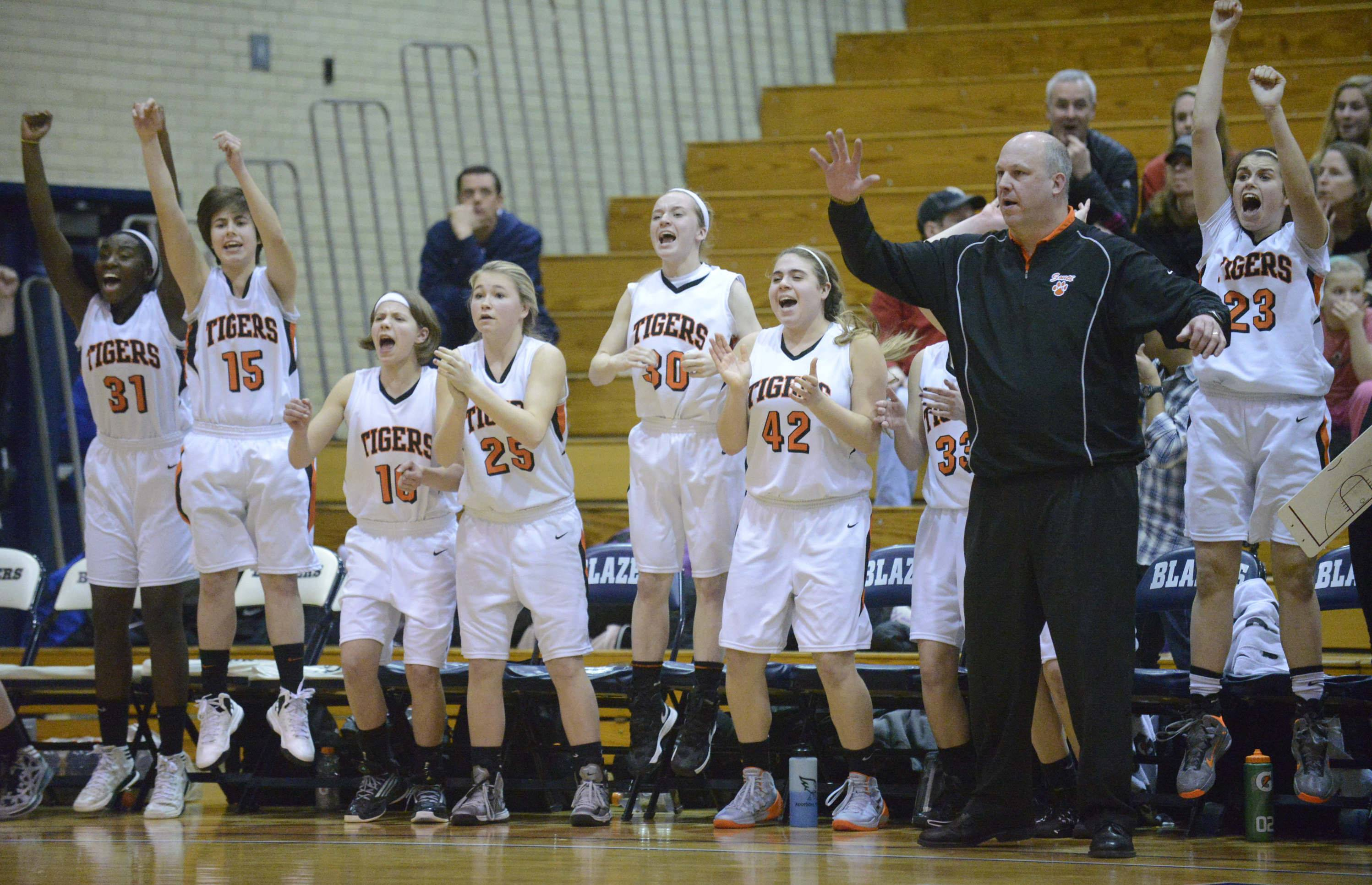 Images from the Geneva vs. Wheaton Warrenville South girls sectional semifinal basketball game Tuesday, February 25, 2014 in Addison.