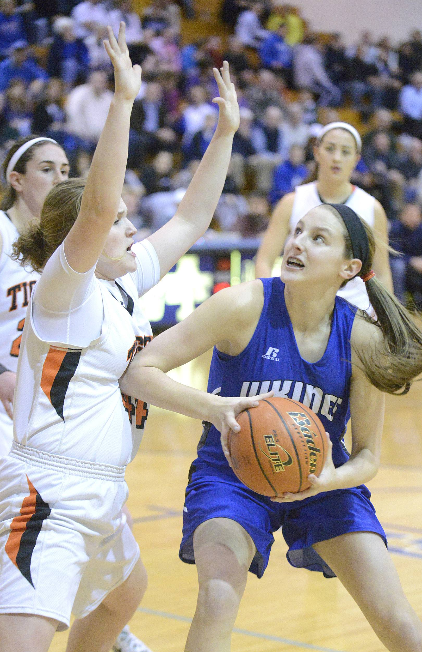 Wheaton Warrenville South's Olivia Linebarger attempts to block a shot by Geneva's Grace Loberg in the first quarter.