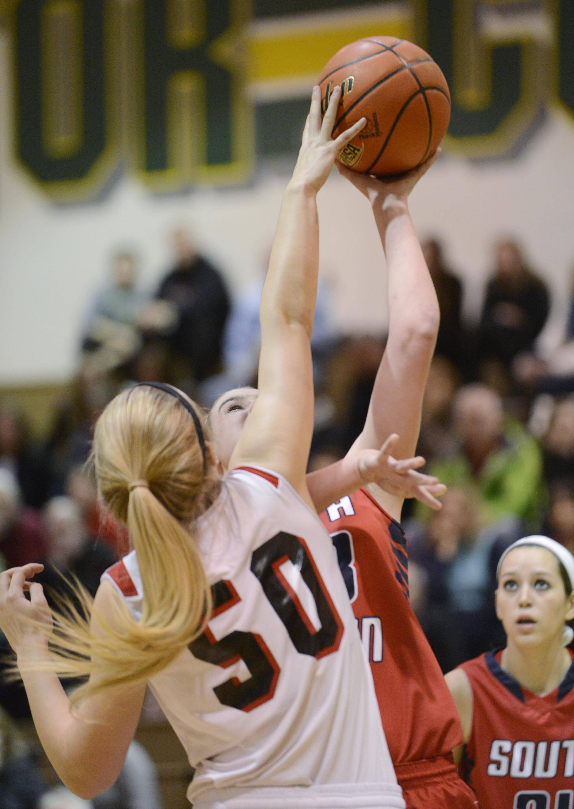 Huntley's Ali Andrews blocks South Elgin's Mackie Kelleher in the Class 4A Crystal Lake South sectional game Tuesday.