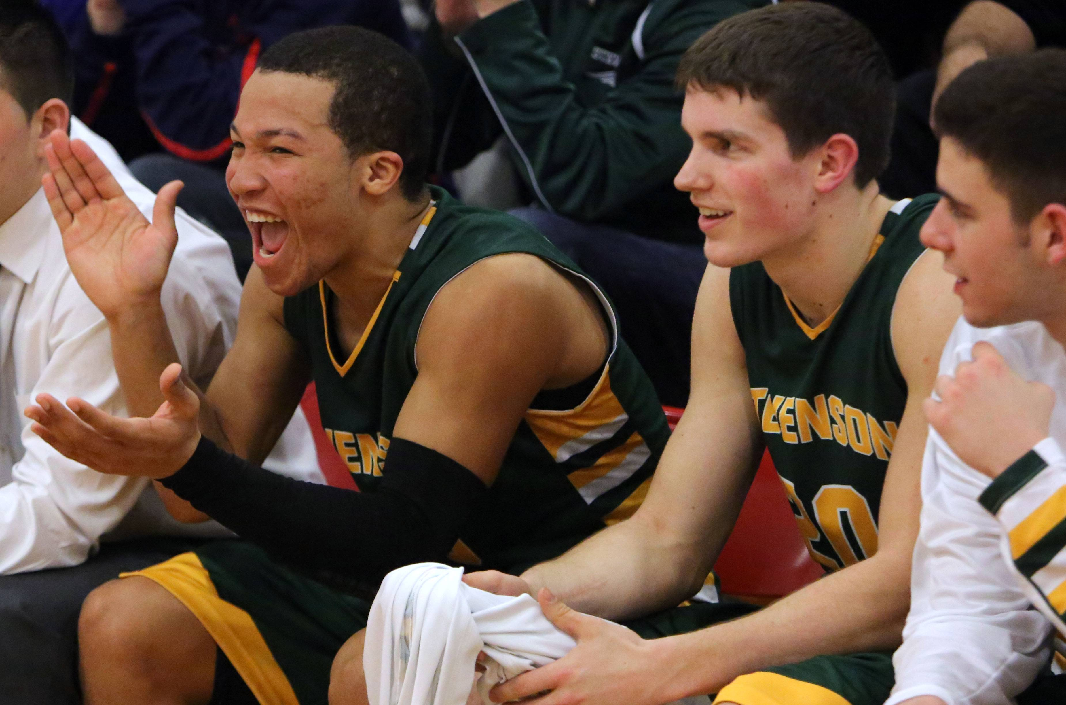From left, Stevenson's Jalen Brunson, Matt Morrissey and Parker Nichols cheer from the bench during the Patriots' victory over North Chicago in the North Suburban Conference championship game Wednesday night at North Chicago.