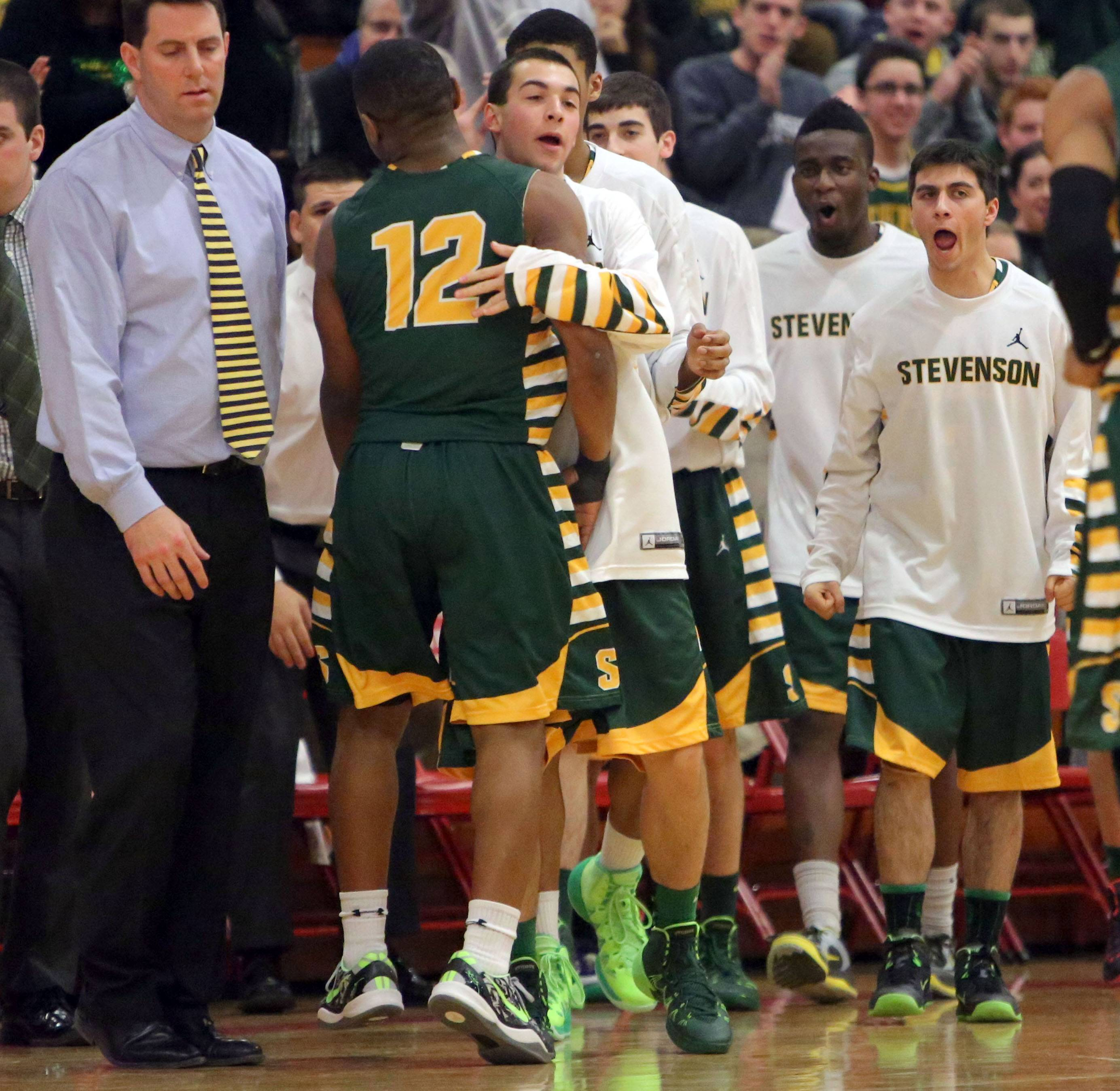 Stevenson's Matt Johnson is greeted by the bench during their victory over North Chicago in the North Suburban Conference championship game Wednesday night at North Chicago.