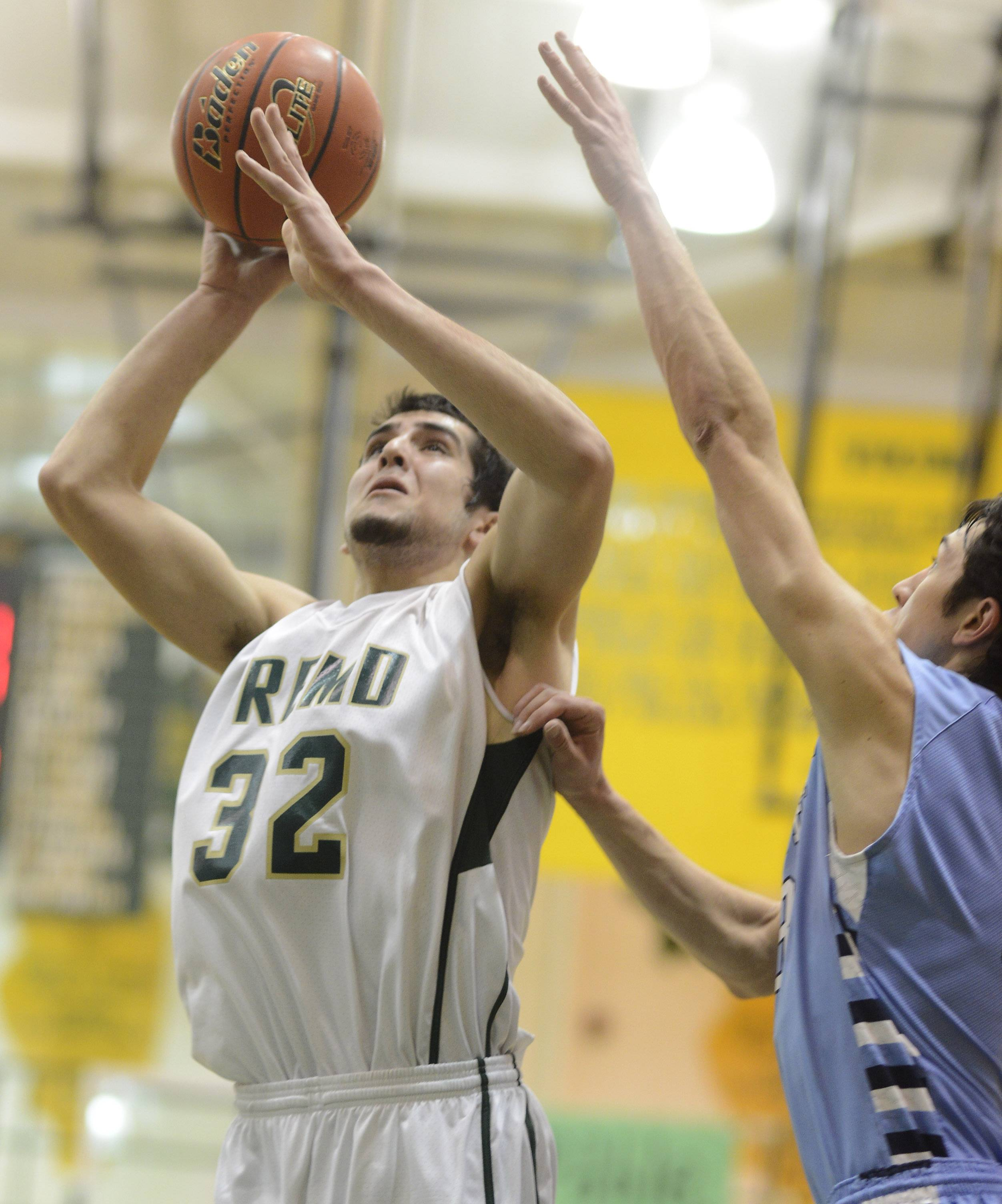 Fremd's Matthew Ochoa shoots while being guarded by Prospect's Bobby Frasco .