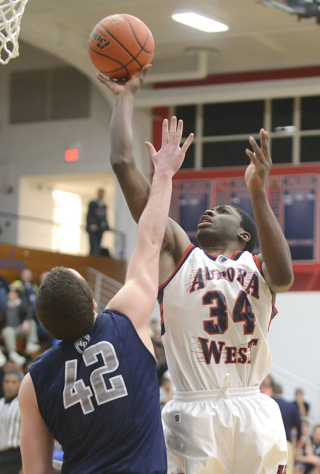 West Aurora's Roland Griffin shoots over a block by Lake Park's John Hower in the third quarter.