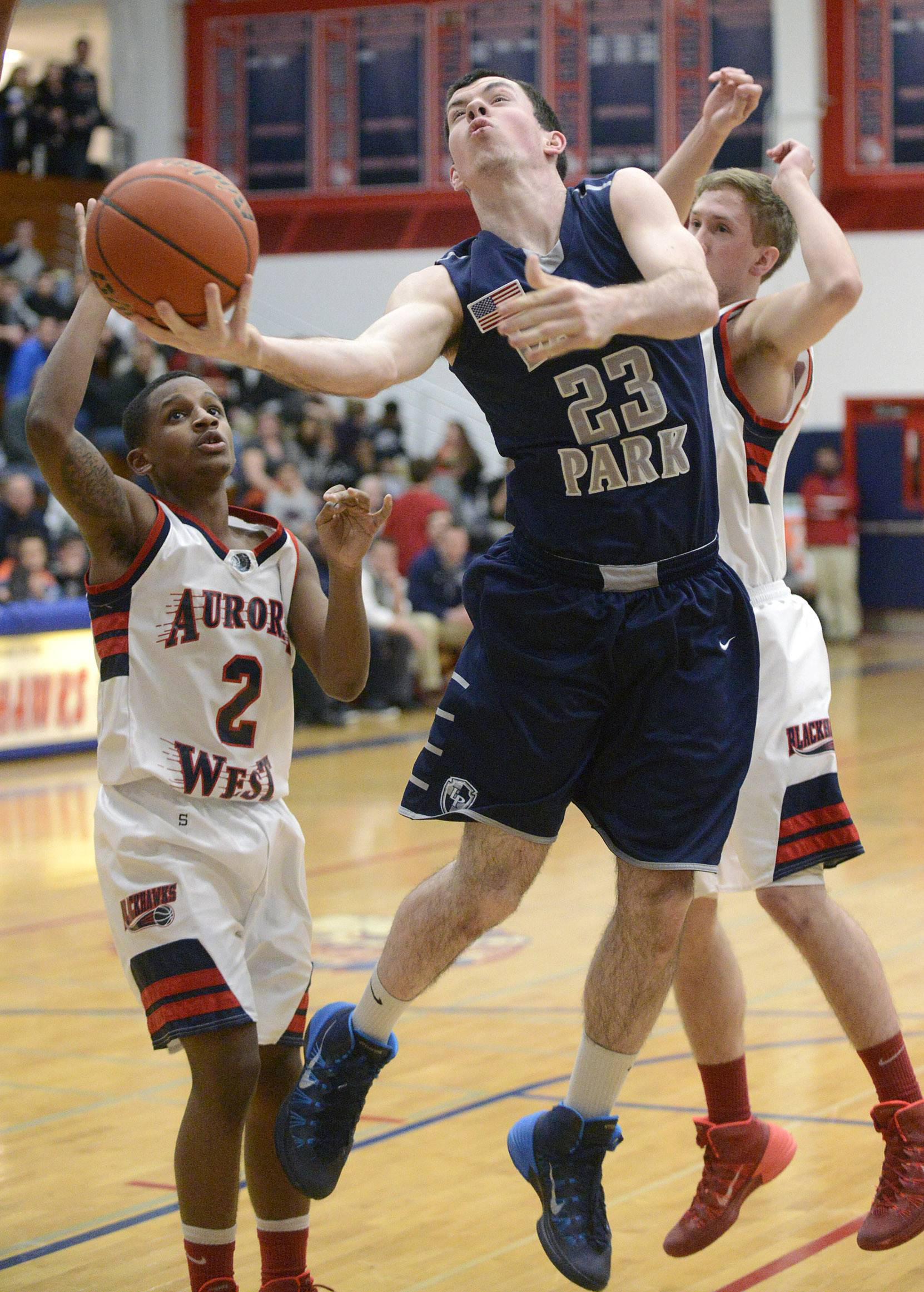 Lake Park's Sean Moore shoots around West Aurora's Matt Dunn, left,  and Tommy Koth, right, in the first quarter.