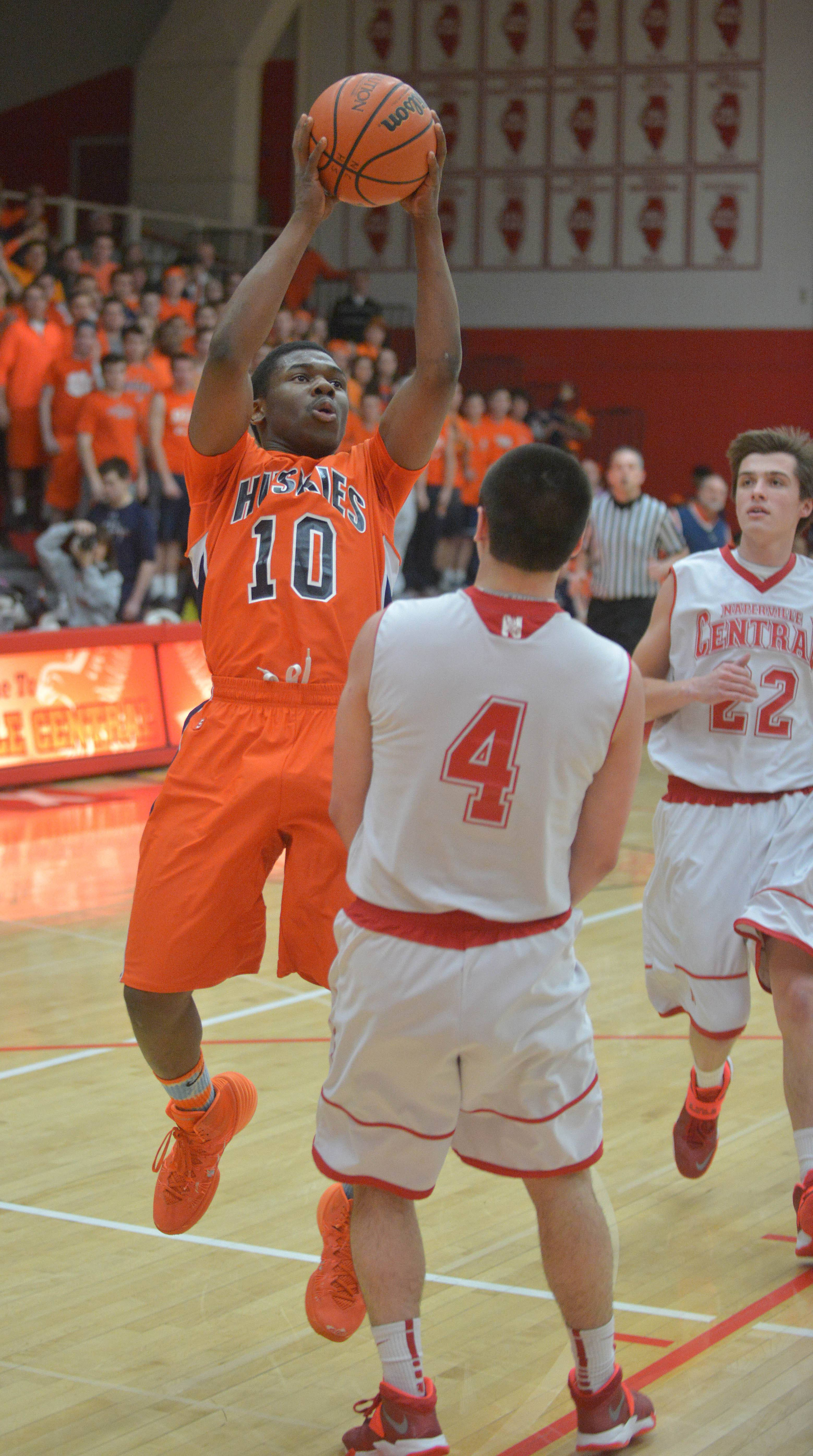 Jelani McClain, Jr. takes a shot over  Ryan Antony of Naperville Central.