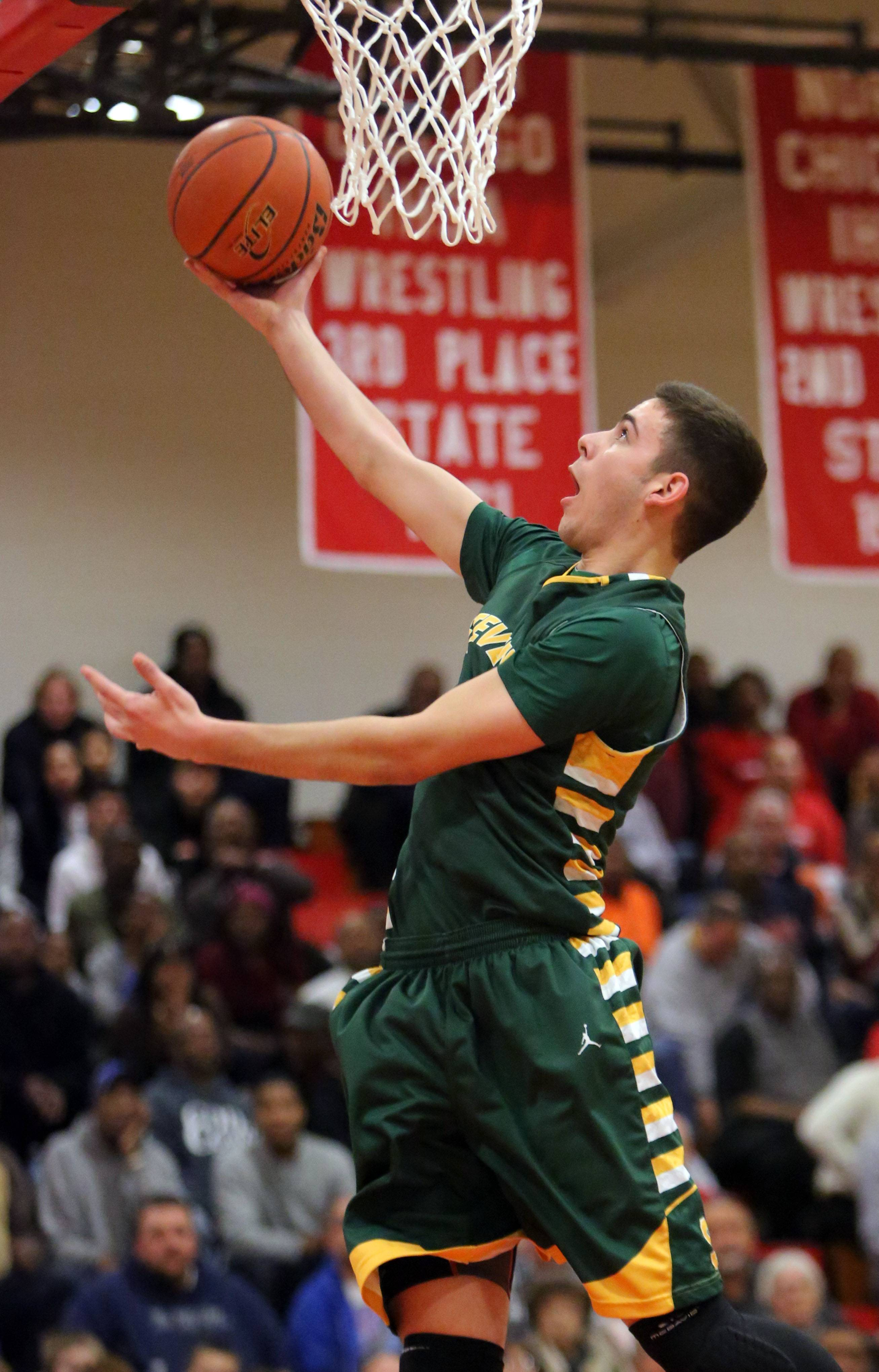 Stevenson's Parker Nichols drives in for an uncontested layup.