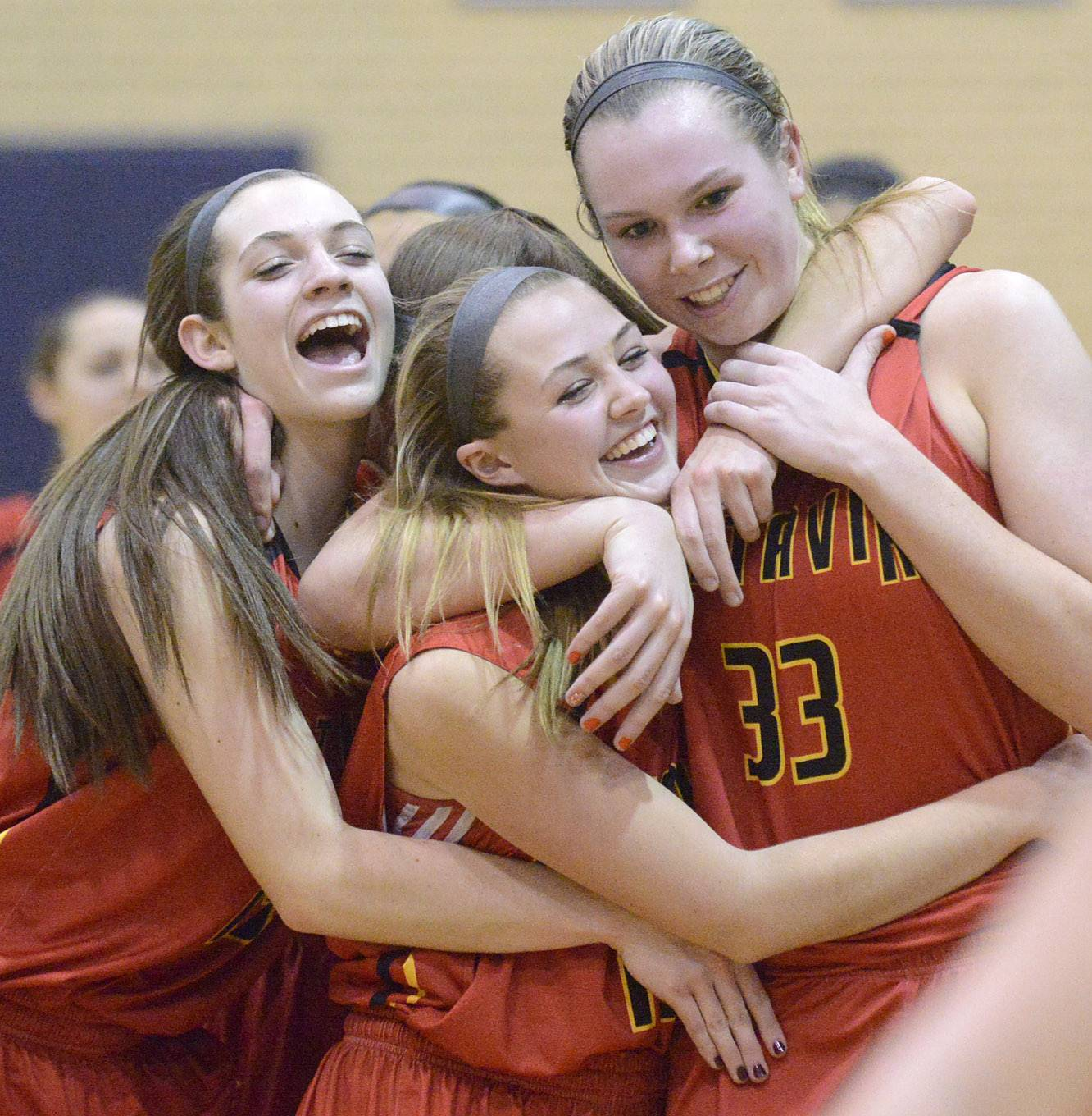 Laura Stoecker/lstoecker@dailyherald.comBatavia's Mackenzie Foster, left, Katie Weber, center, and Erin Bayram, right, embrace as they walk off the court after their 4A sectional semifinal win over Downers Grove North at Addison Trail High School in Addison on Tuesday, February 25.