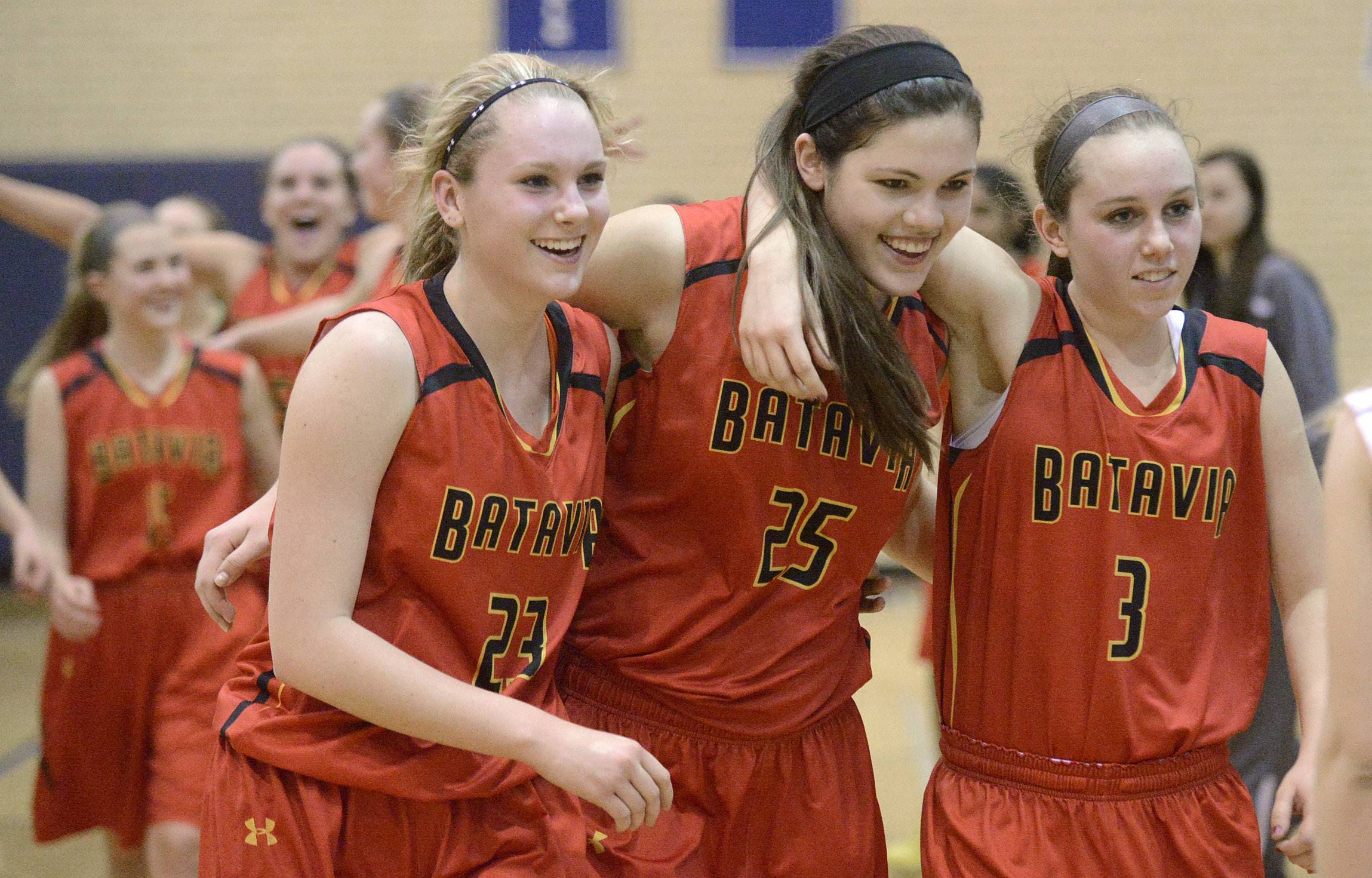 Laura Stoecker/lstoecker@dailyherald.com  Batavia's Mackenzie Foster, left, Katie Weber, center, and Erin Bayram, right, embrace as they walk off the court after their 4A sectional semifinal win over Downers Grove North at Addison Trail High School in Addison on Tuesday, February 25.