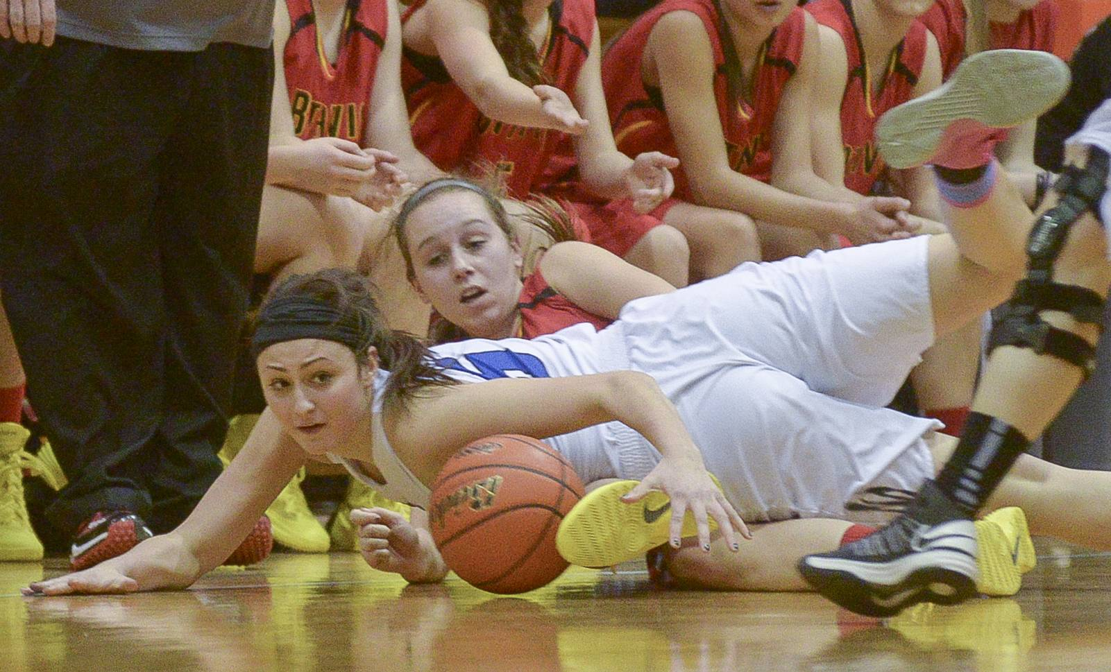Geneva's Abby Novak and Batavia's Bethany Orman scramble on the ground for control of the ball during the Class 4A girls basketball sectional final game at Addison Trail in Addison, Thursday.