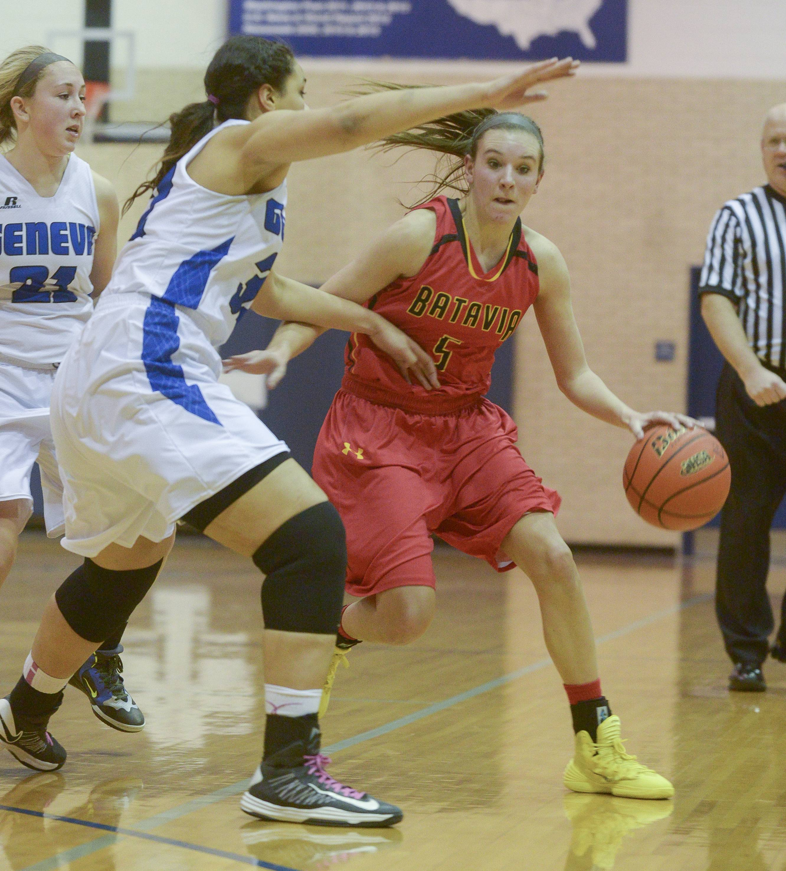Batavia's Liza Fruendt drives around Geneva defenders during the Class 4A girls basketball sectional final game at Addison Trail in Addison, Thursday.