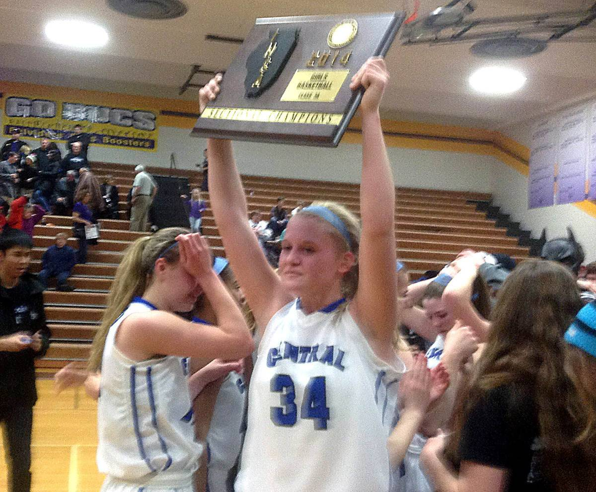 Burlington Central sophomore Sam Pryor hoists the sectional championship plaque after the Rockets' 55-41 win over Rockford Lutheran Thursday night in the Class 3A Belvidere sectional final.