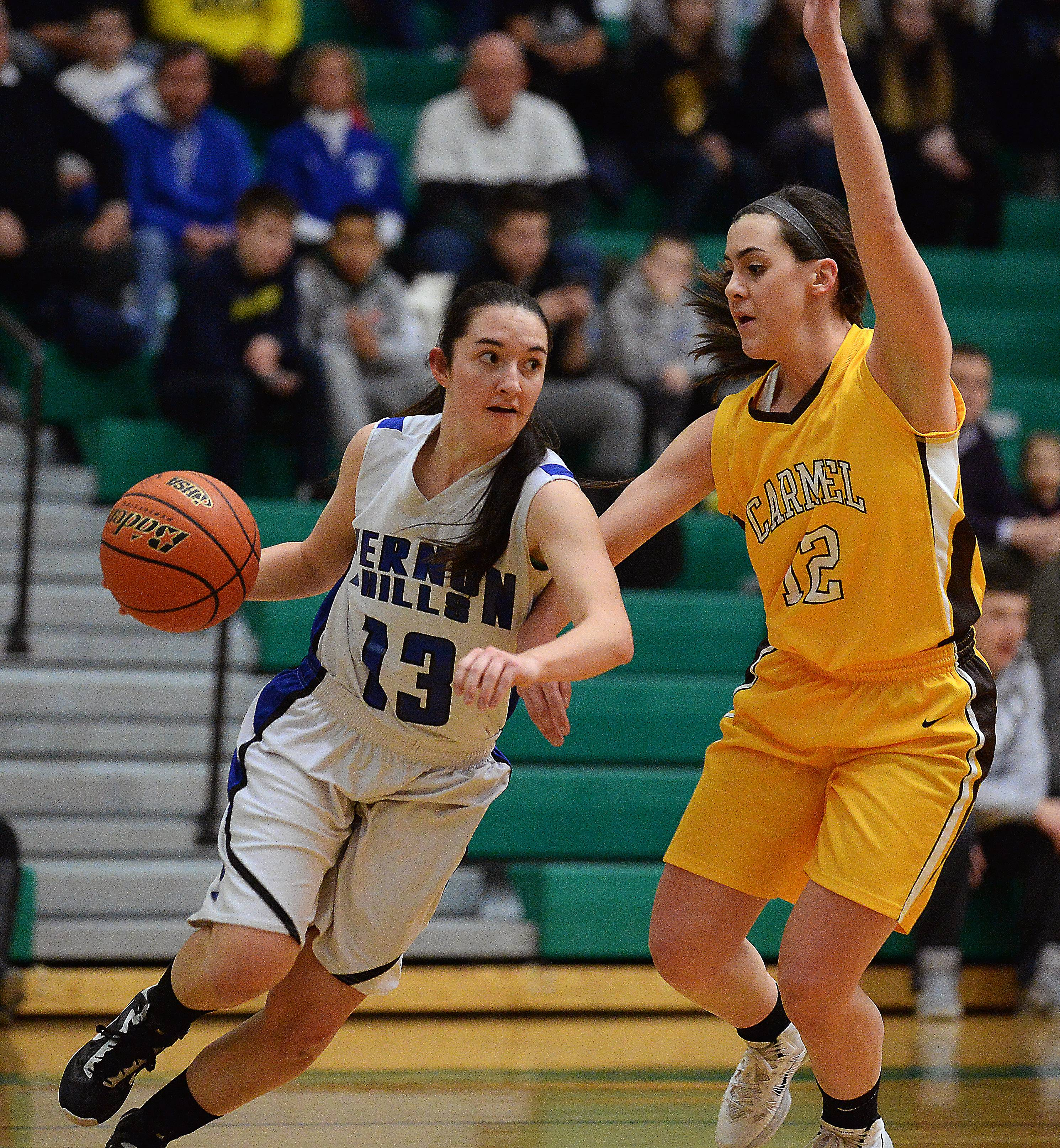 Vernon Hills' Katherine Koczwara moves around Carmel's Kathleen Fellcelli in the first half of Class 3A sectional final play at Ridgewood High School on Thursday.