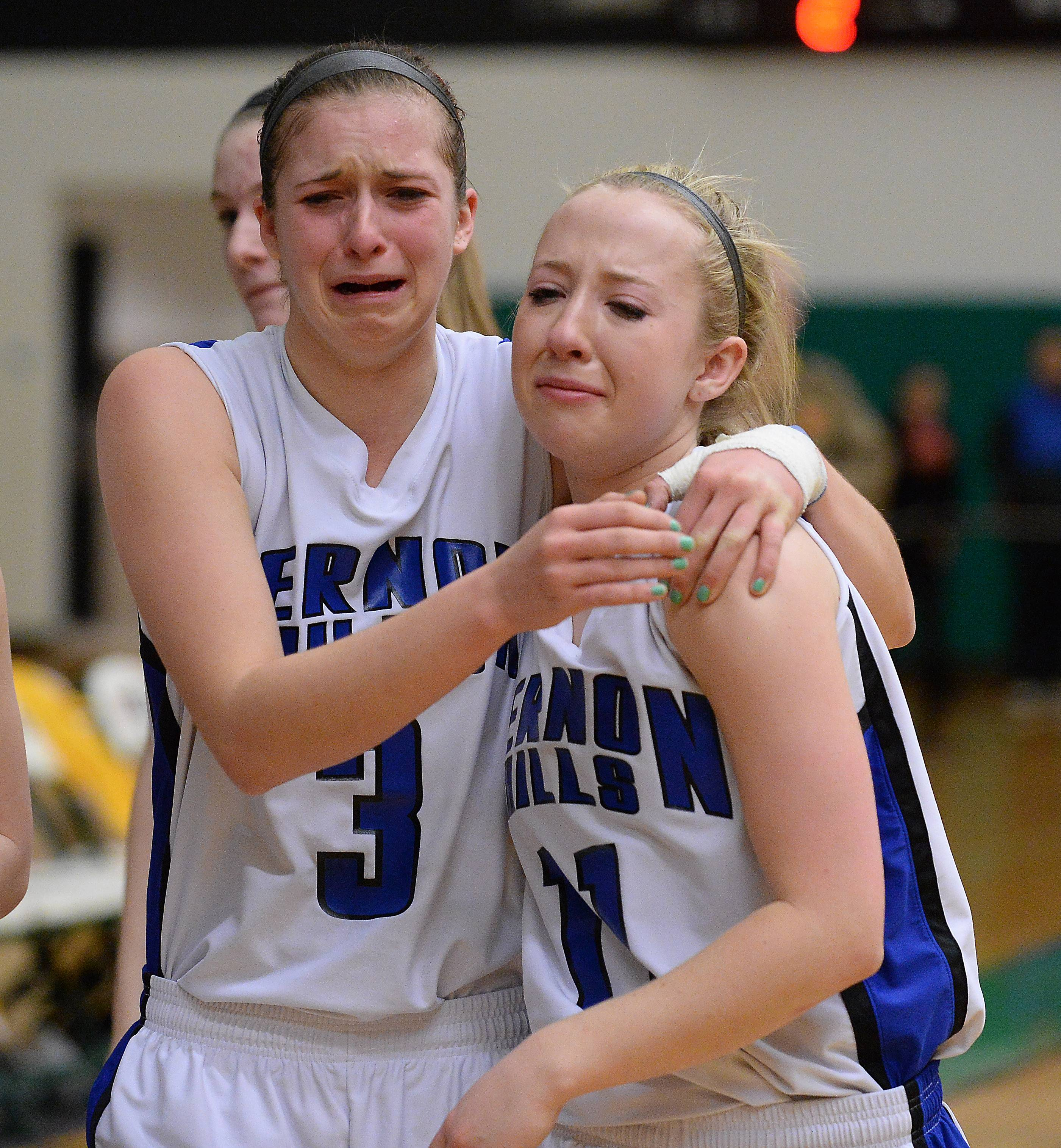 Vernon Hills' Dana Meline (3) and Haley Lieberman (11) feel the sting of a loss to Carmel in the Class 3A sectional championship game at Ridgewood High School on Thursday.