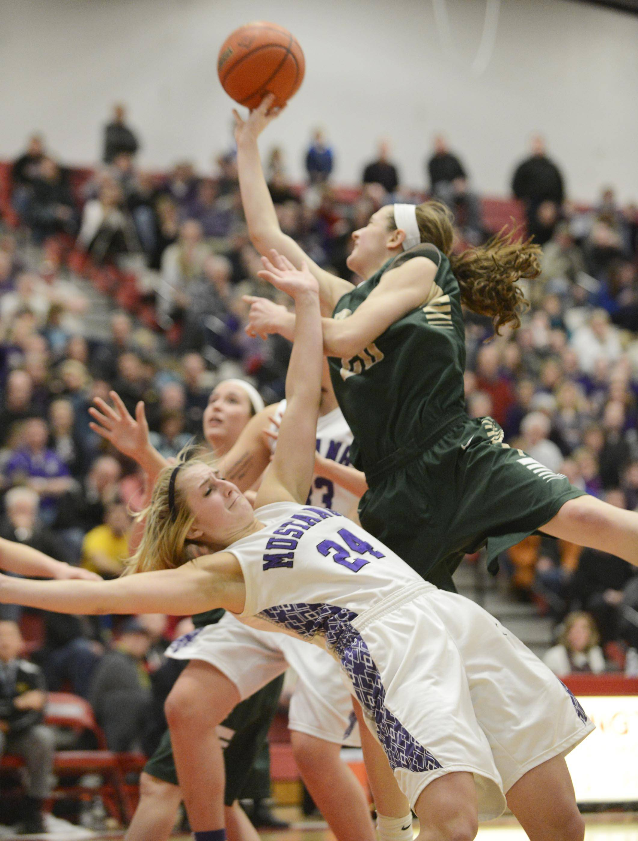 Fremd's Haley Gorecki shoots over Rolling Meadows' Alexis Glasgow on Thursday at Barrington. A foul was called on Glasgow.