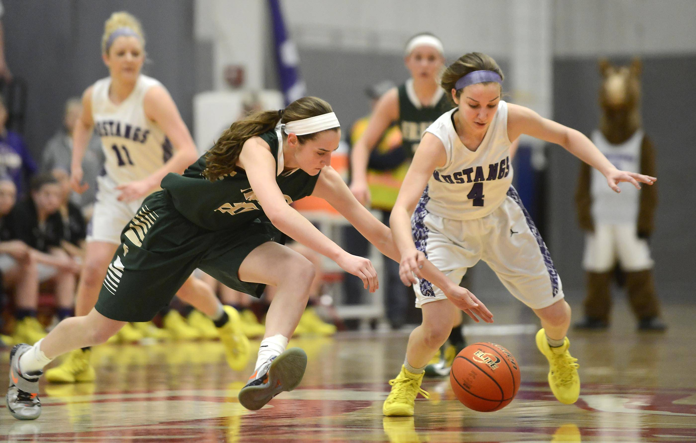 Fremd's Haley Gorecki and Rolling Meadows' Sami Kay charge for the ball after Gorecki knocked it loose Thursday in the Barrington Class 4A sectional championship game.