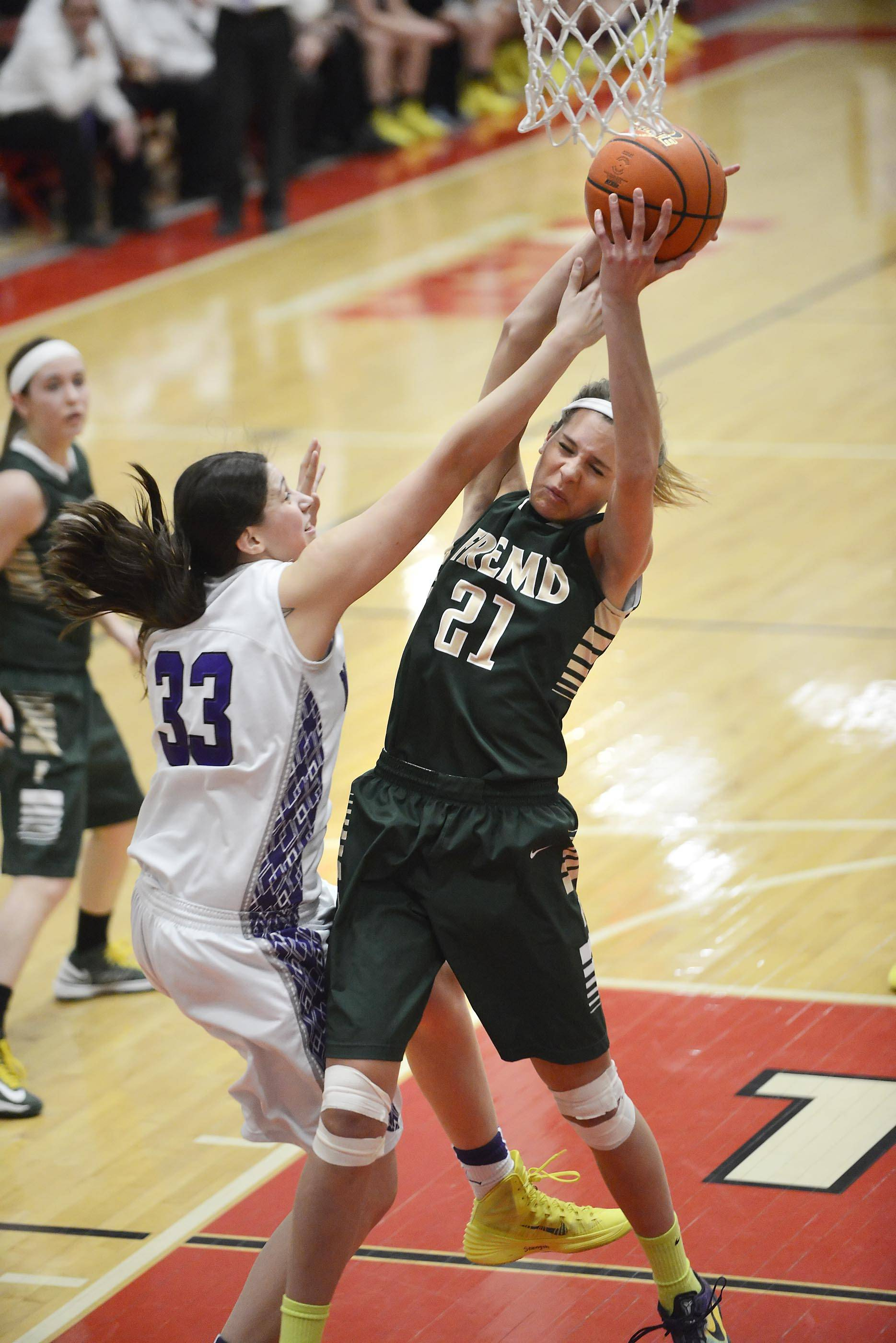 Fremd's Grace Tworek fights for a rebound with Rolling Meadows' Ashley Montanez on Thursday in the Barrington sectional championship game.