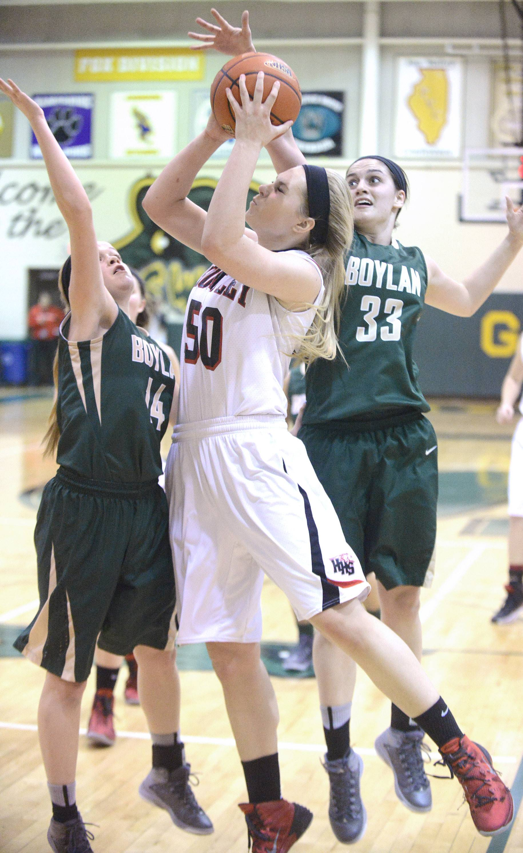 Huntley's Ali Andrews shoots over a block by Rockford Boylan's Allie Zimmerman, left, and Emily Crouch in the second quarter of the Class 4A sectional championship at Crystal Lake South Thursday.