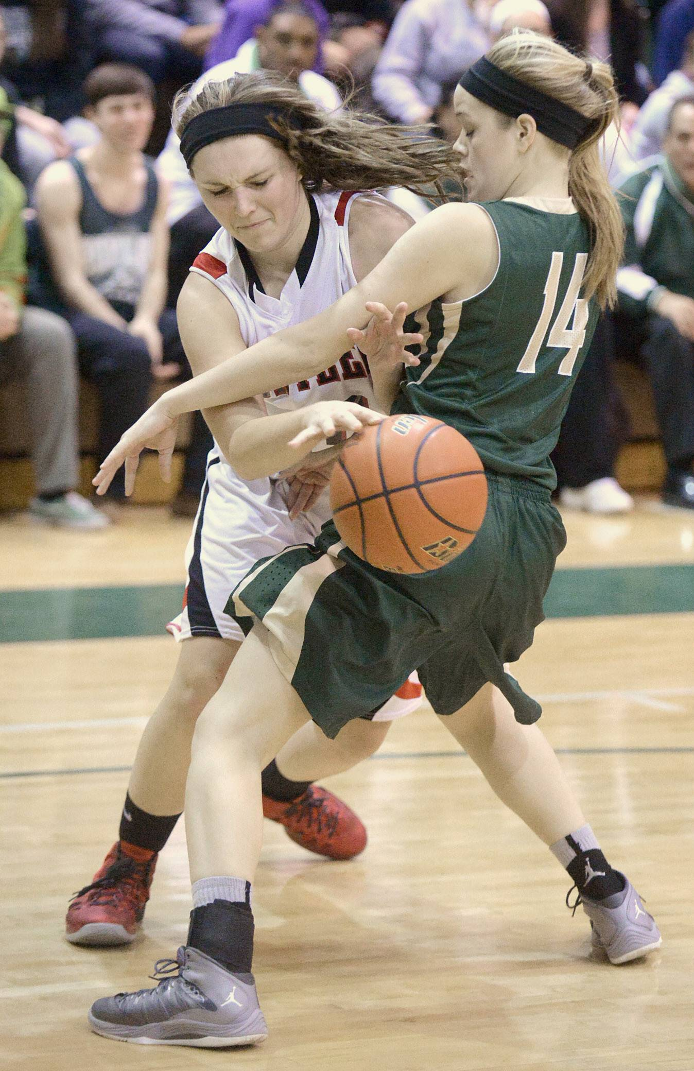 Huntley's Samantha Andrews maneuvers around a block by Rockford Boylan's Allie Zimmerman in second quarter of the Class 4A sectional championship at Crystal Lake South Thursday.