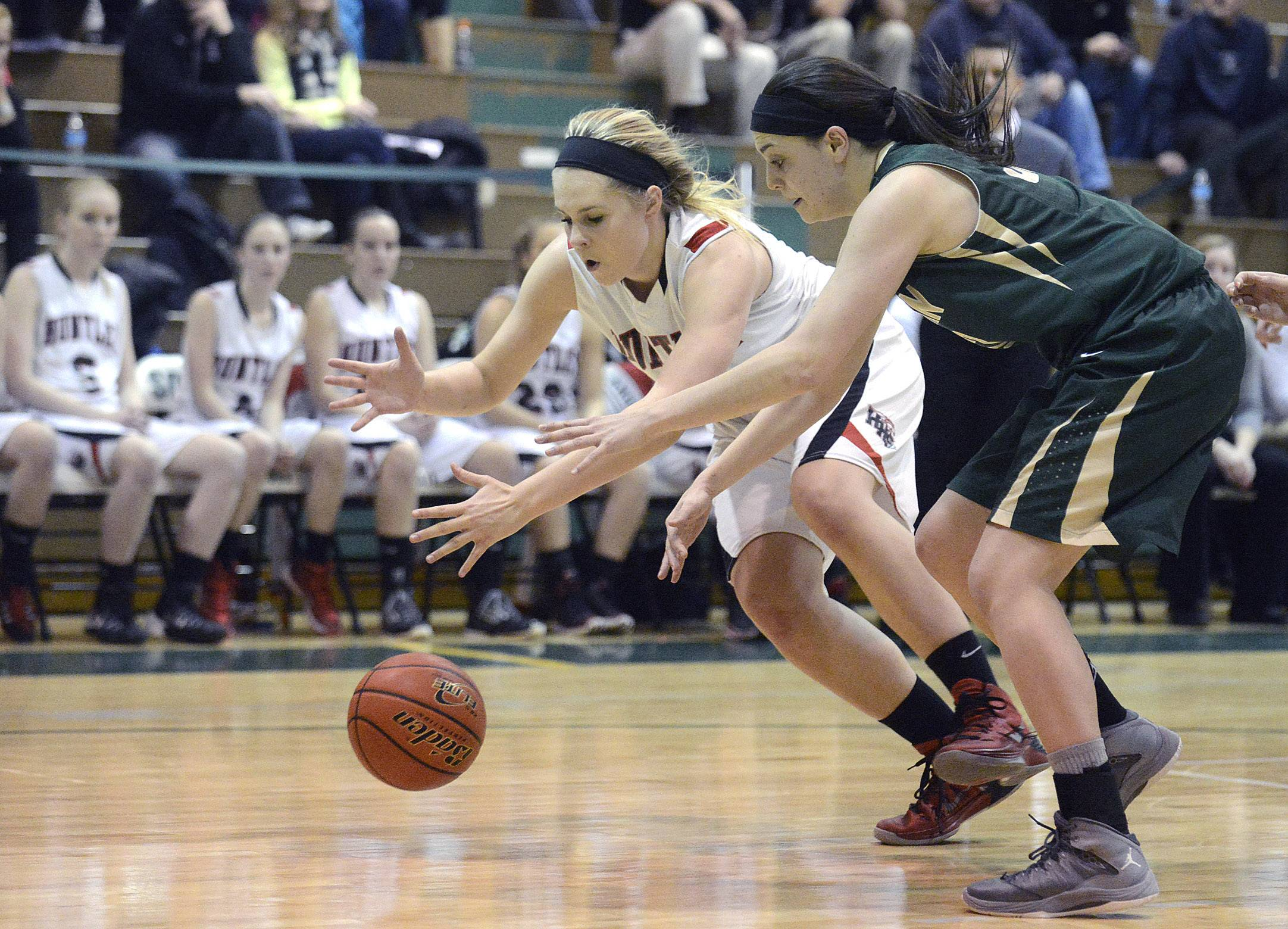 Huntley's Ali Andrews and Rockford Boylan's Emily Crouch race for a loose ball in the fourth quarter of the Class 4A sectional championship at Crystal Lake South on Thursday.