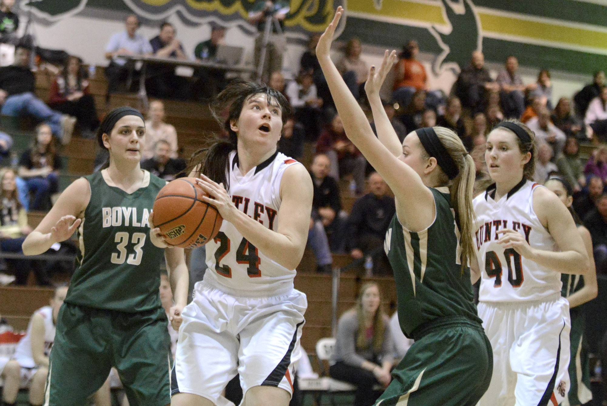 Huntley's Bethany Zornow looks to shoot over a block by Rockford Boylan's Allie Zimmerman in the fourth quarter of the Class 4A sectional championship at Crystal Lake South High School in Crystal Lake on Thursday, February 27.