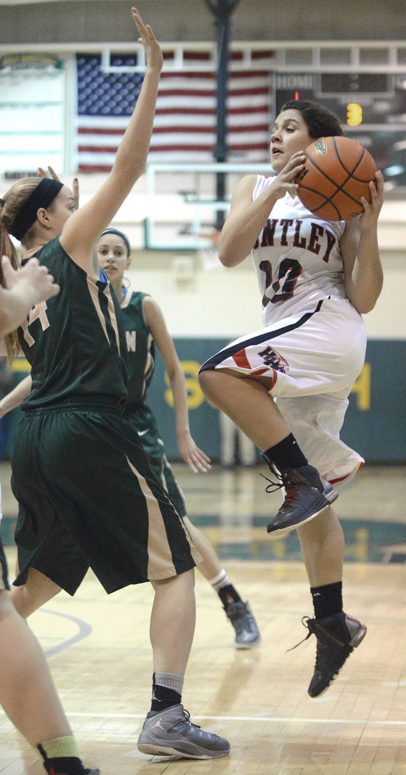 Huntley's Kayla Barreto shoots over a block by Rockford Boylan's Allie Zimmerman in the third quarter of the Class 4A sectional championship at Crystal Lake South Thursday.