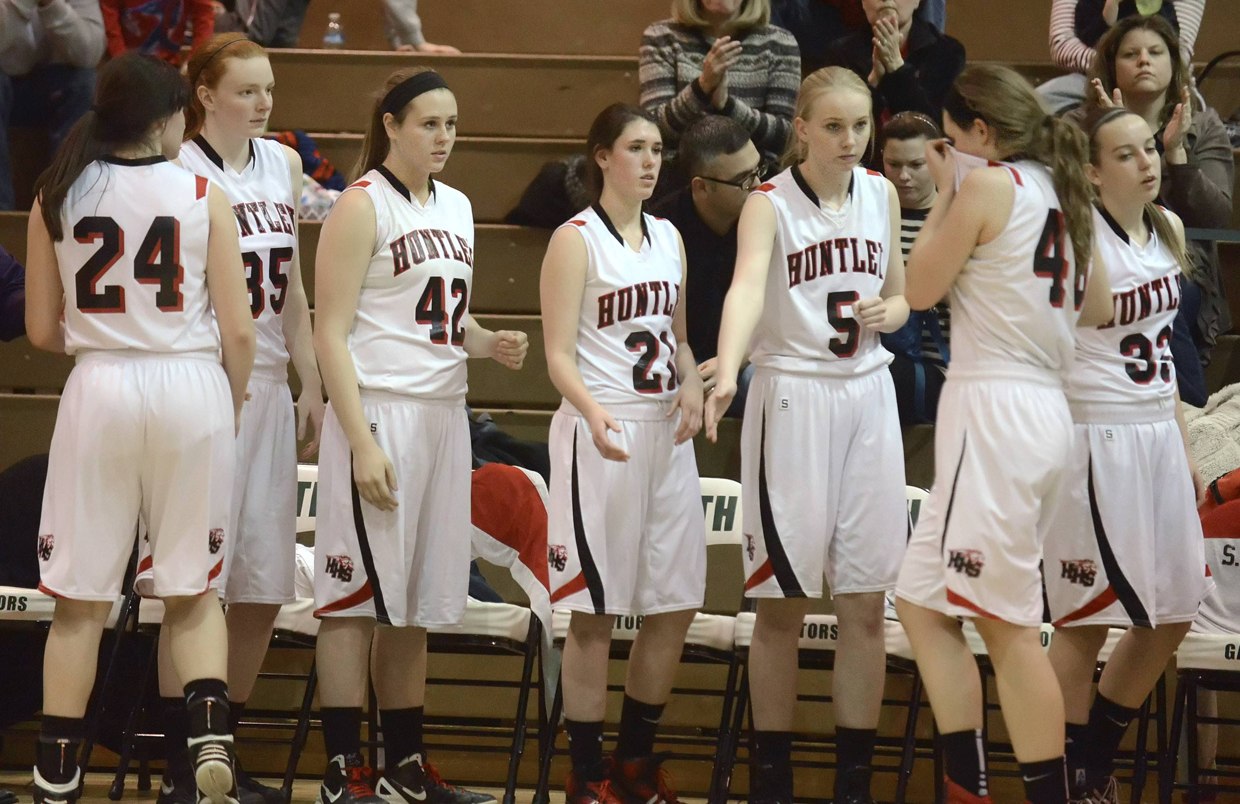Huntley's Ali Andrews is comforted by teammates as she comes off the court in the final seconds of the Class 4A sectional championship game at Crystal Lake South Thursday.