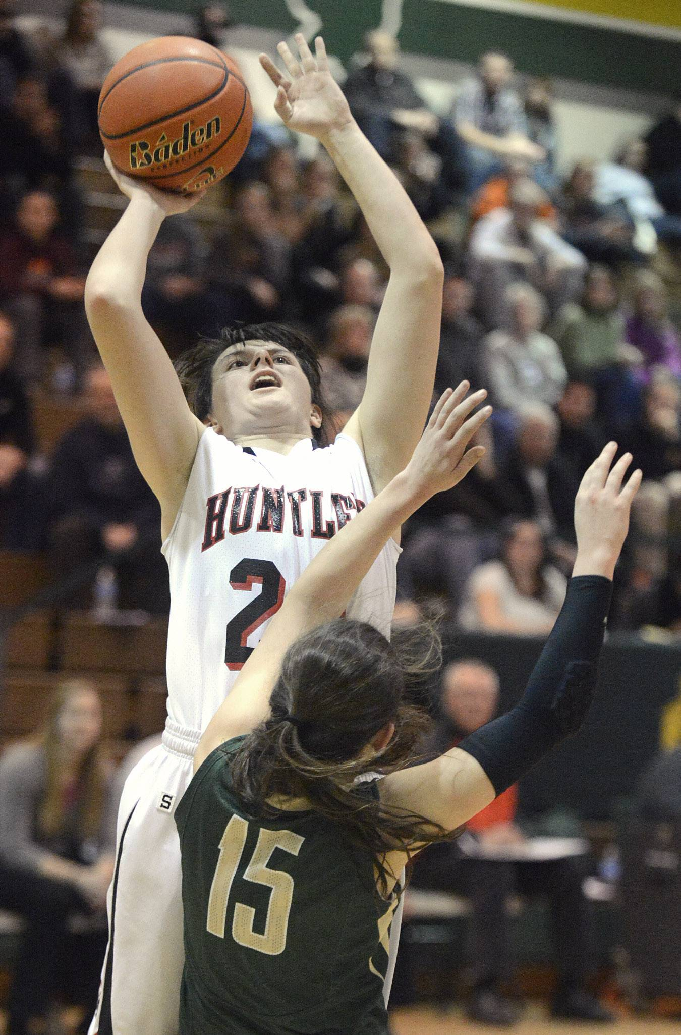 Huntley's Bethany Zornow shoots over a block by Rockford Boylan's Jensen Blassage in the third quarter of the Class 4A sectional championship at Crystal Lake South Thursday.