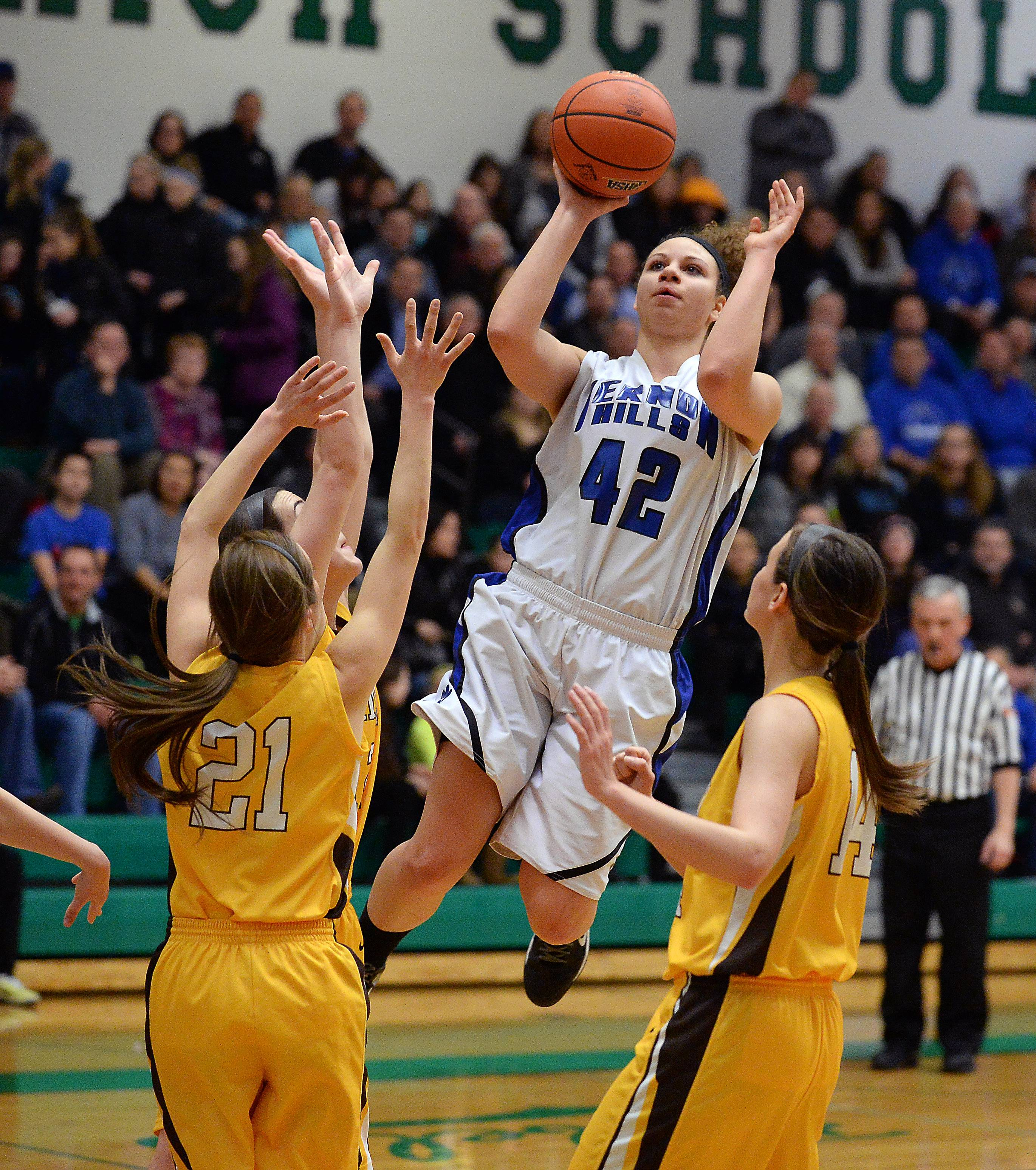Vernon Hills' Lauren Webb  splits Carmel's defense of Nicole Bitter and Cassidy Kloss .