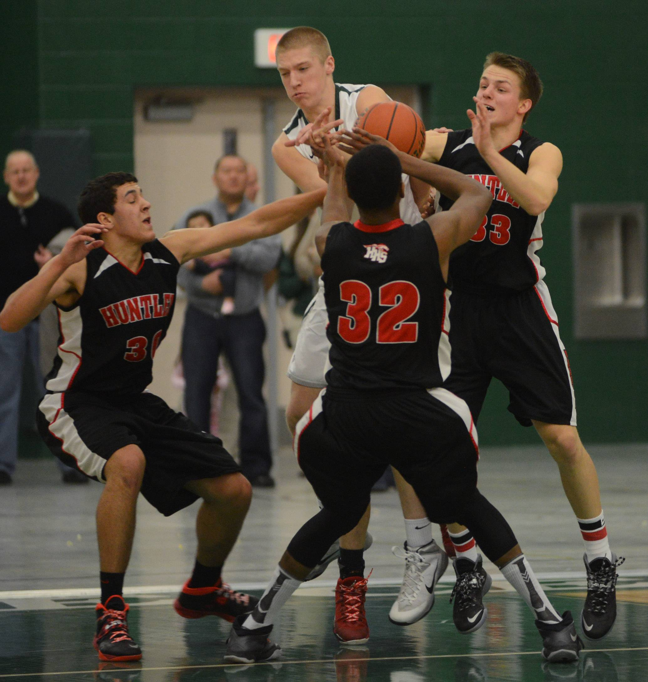 Grayslake Central's Jack Beckman, center, is pressured by a host of Huntley players Friday night in Grayslake.