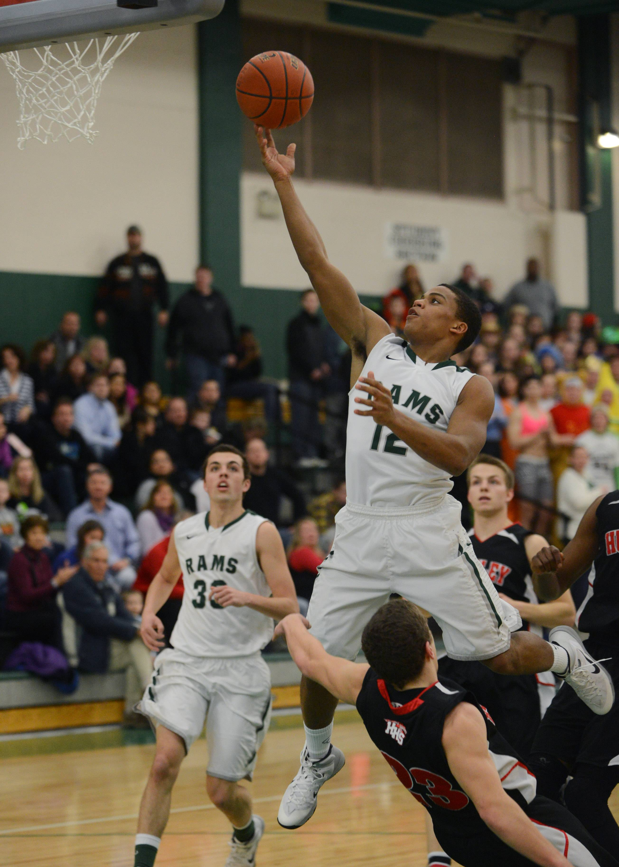 Grayslake Central's Malcolm Reed (12) heads to the hoop during Friday night's home game against Huntley.