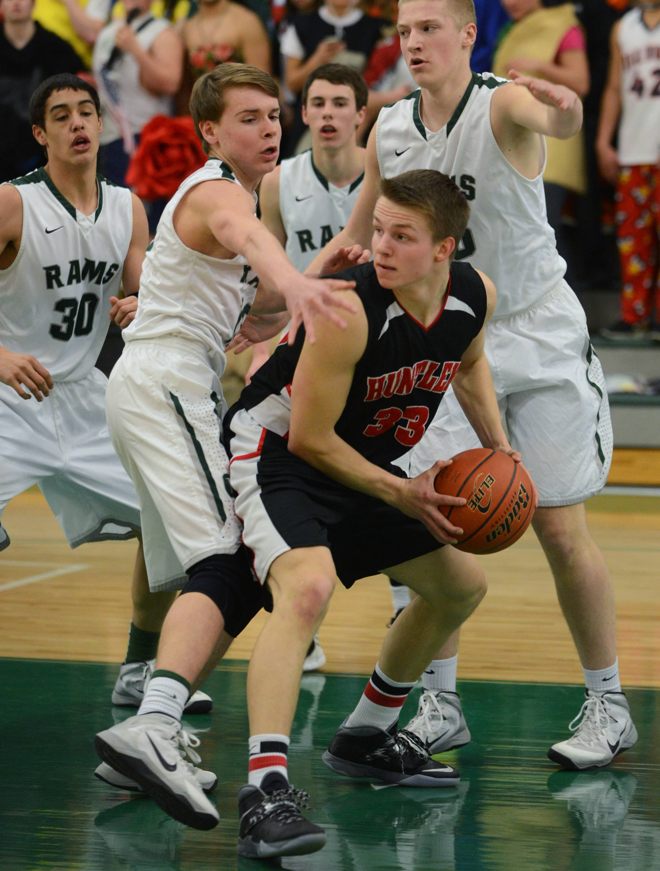 Huntley's Zach Gorney (33) looks to pass under heavy Grayslake Central pressure Friday night in Grayslake.