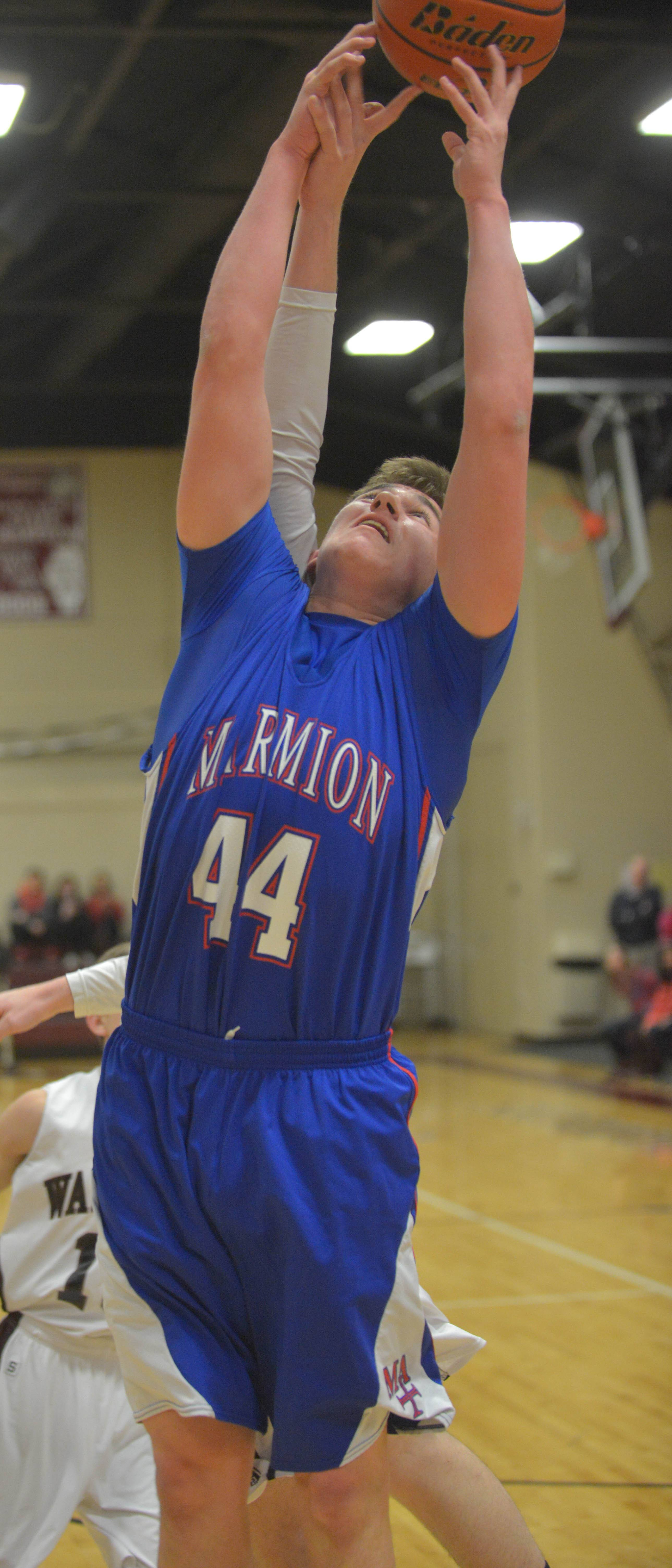 Daniel Bicknell of Marmion Academy goes for a rebound .
