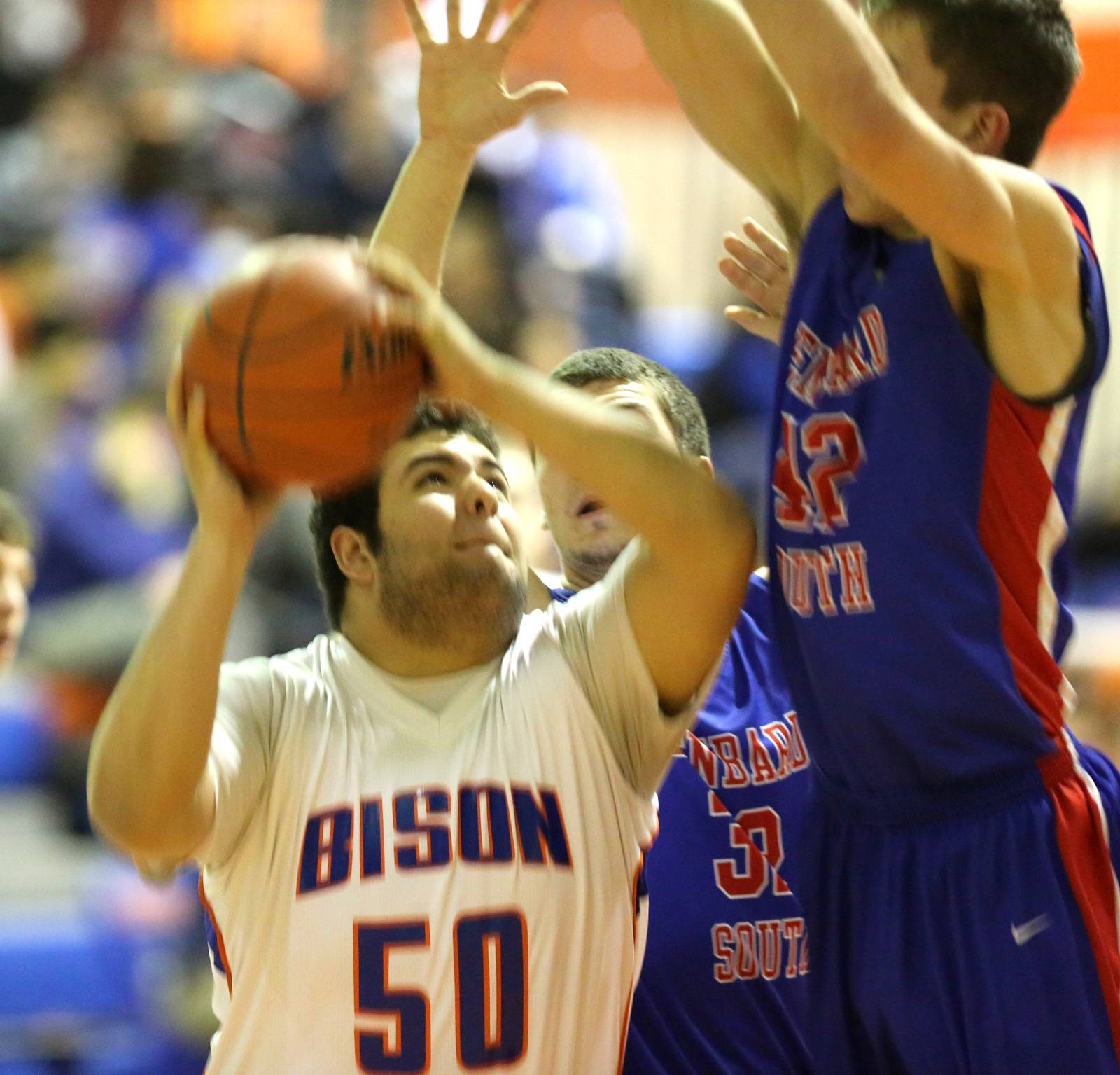 Fenton's David Echeverria drives inside against Glenbard South .