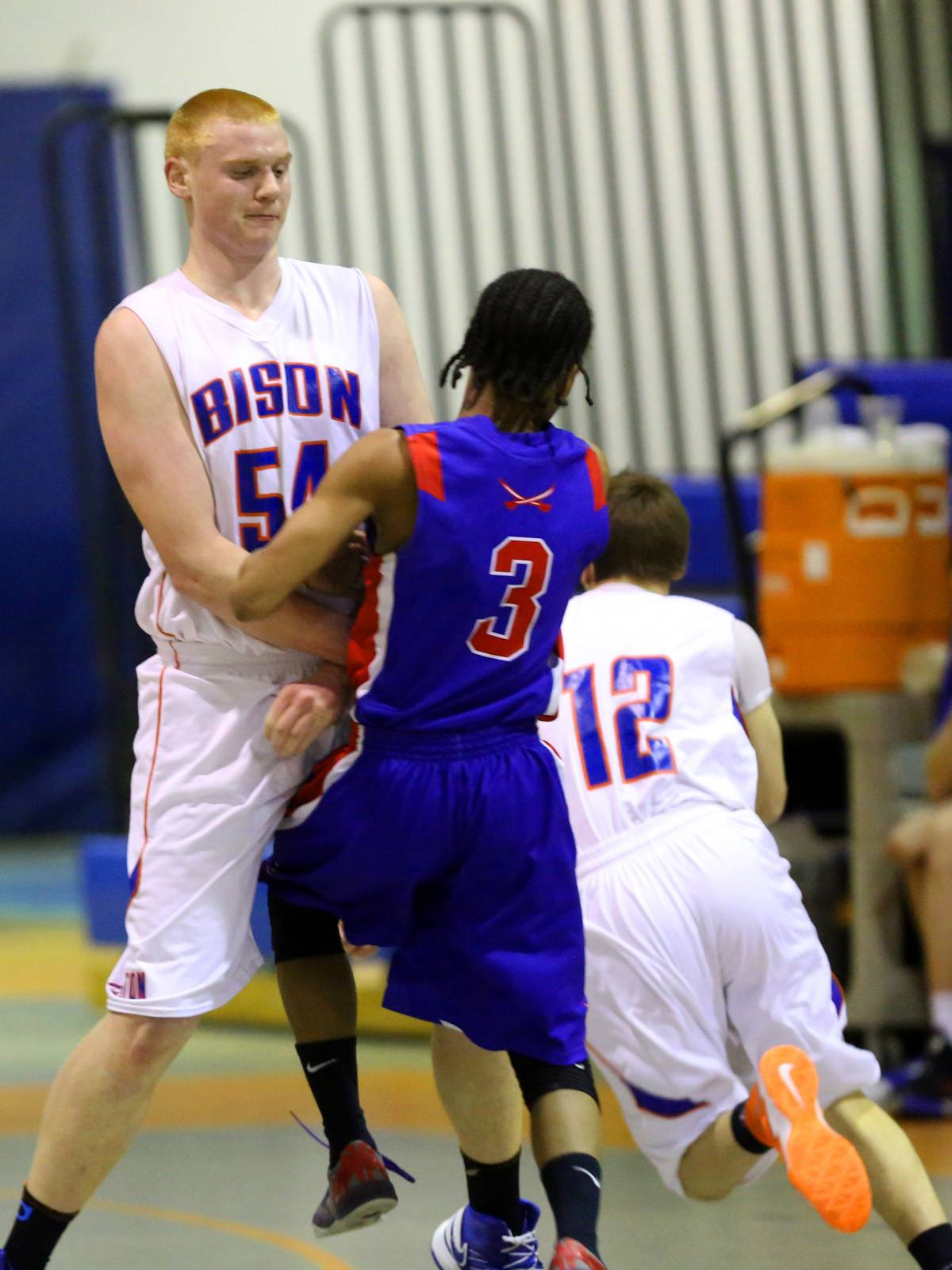 Fenton's Greg Wagner sets a screen against Glenbard South's Chaun Rickette .