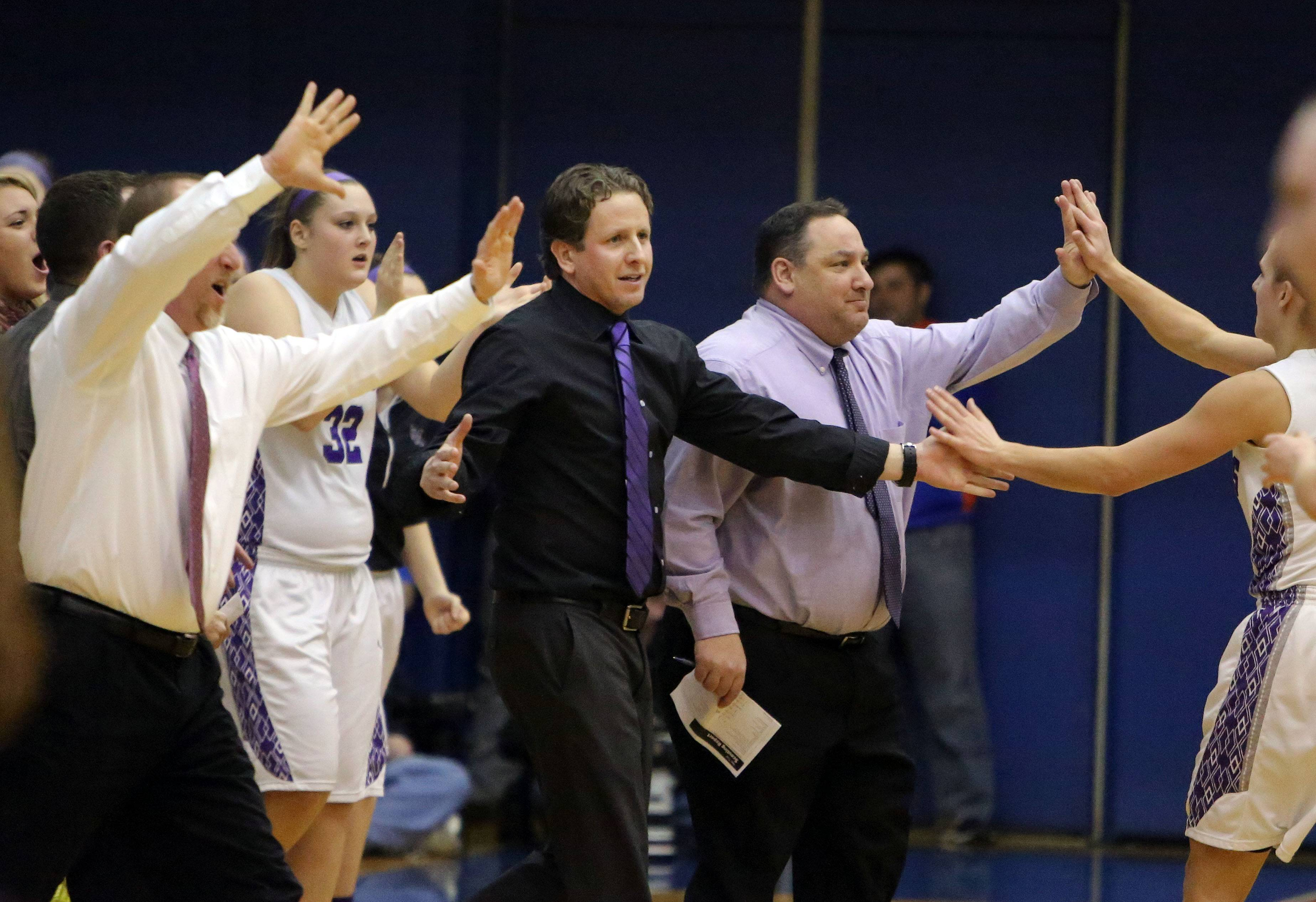 Rolling Meadows coach Ryan Kirkorsky cheers for his team during the Class 4A supersectional against New Trier at Hoffman Estates on Monday.