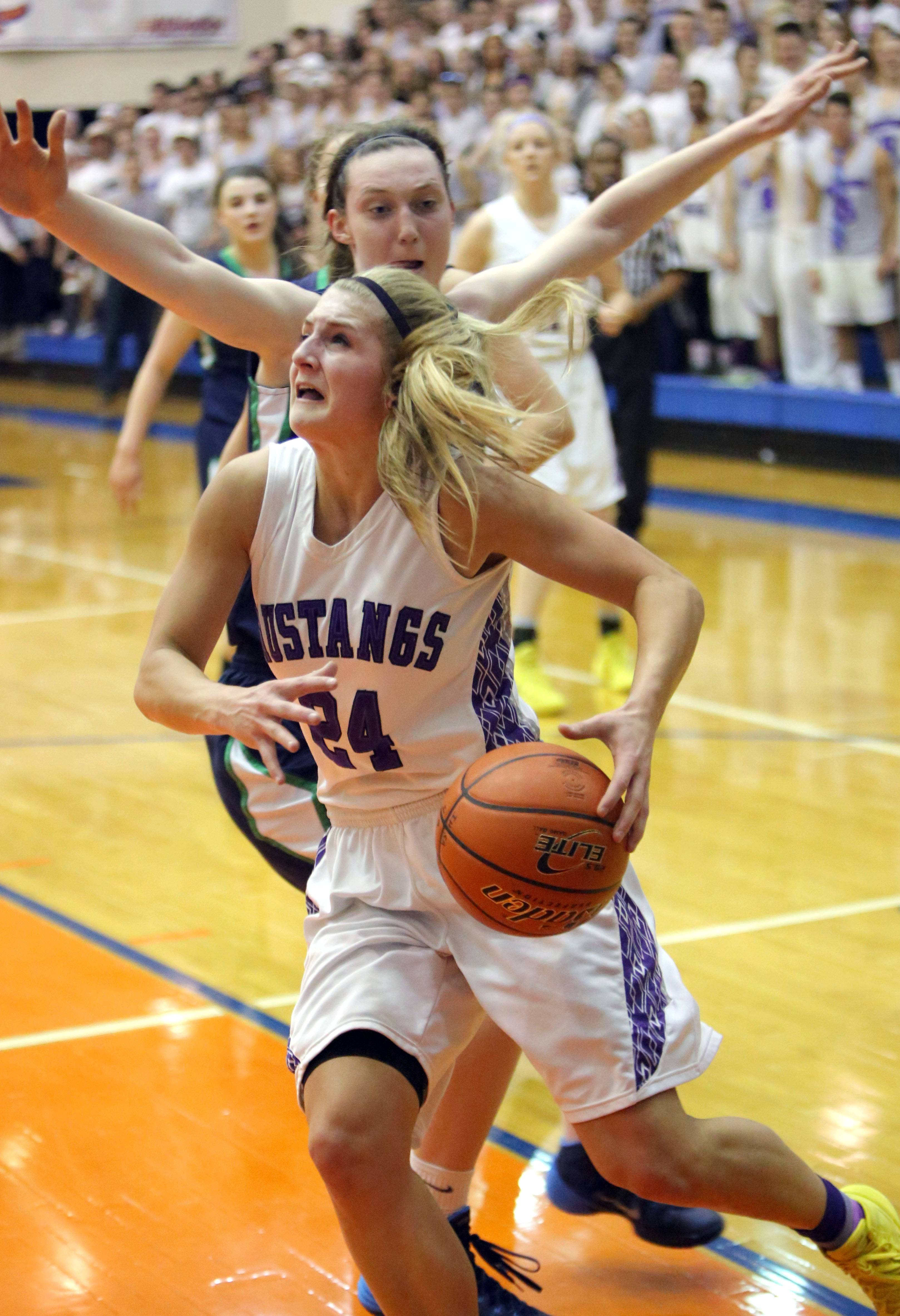 Rolling Meadows' Alexis Glasgow drives past New Trier's Jeannie Boehm during the Class 4A supersectional at Hoffman Estates on Monday.