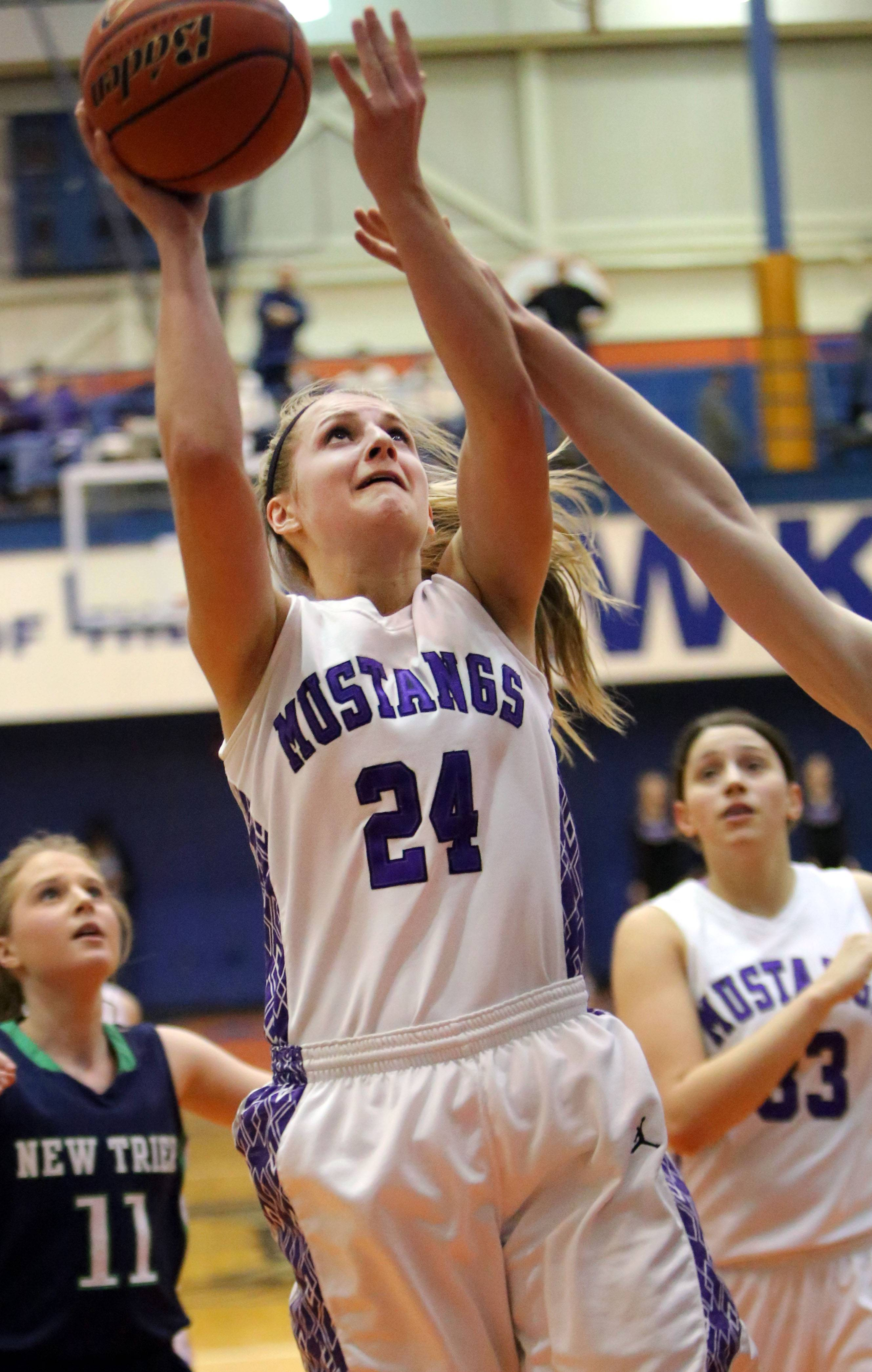 Rolling Meadows' Alexis Glasgow drives to the hoop.
