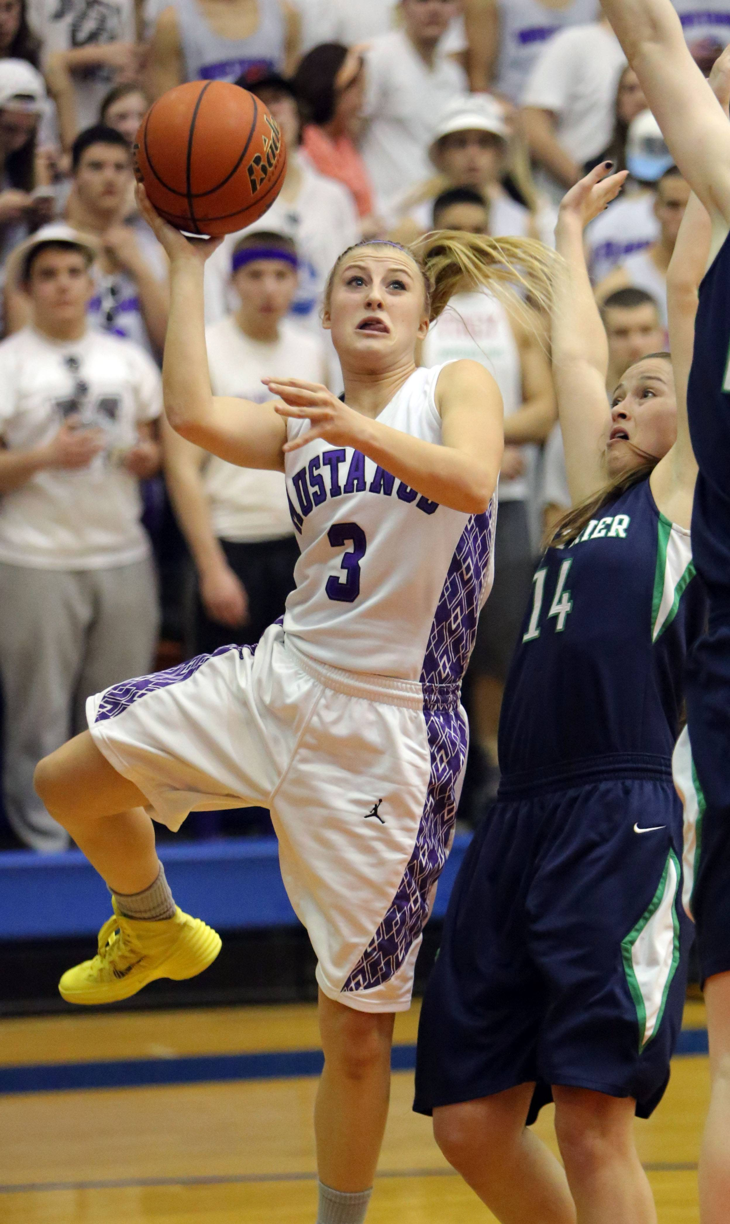 Rolling Meadows' Jackie Kemph, left, drives on Jackie Welch.