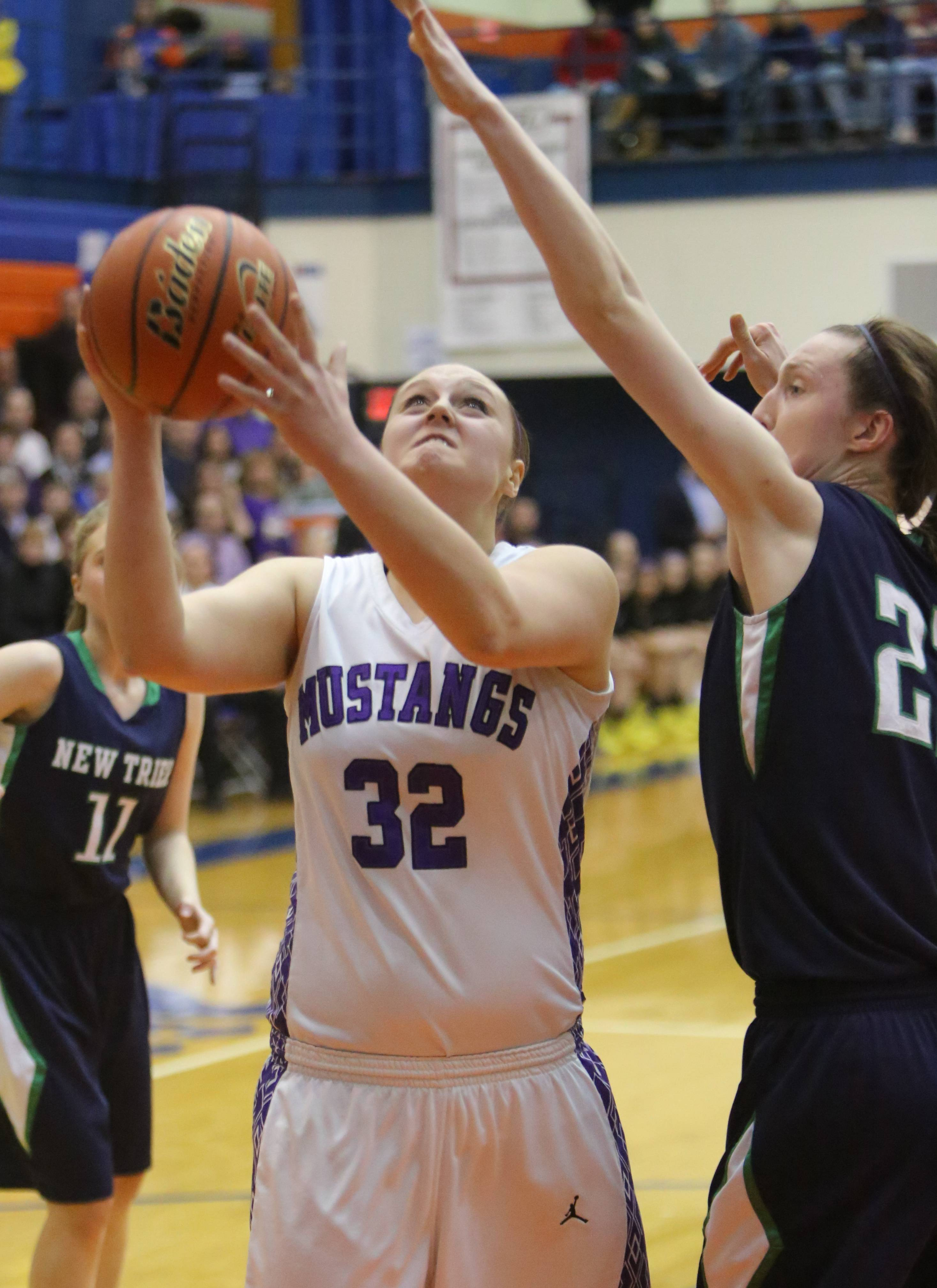 Images from the Rolling Meadows vs. New Trier girls basketball game on Monday, March 3 in Hoffman Estates.