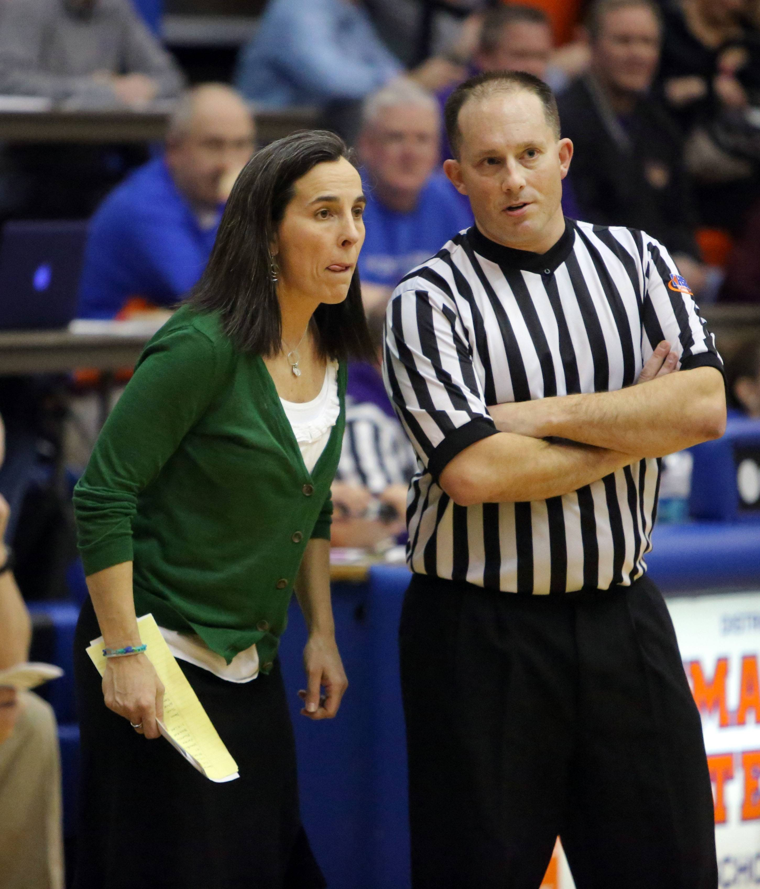 New Trier head coach Teri Rodgers talks to the ref.