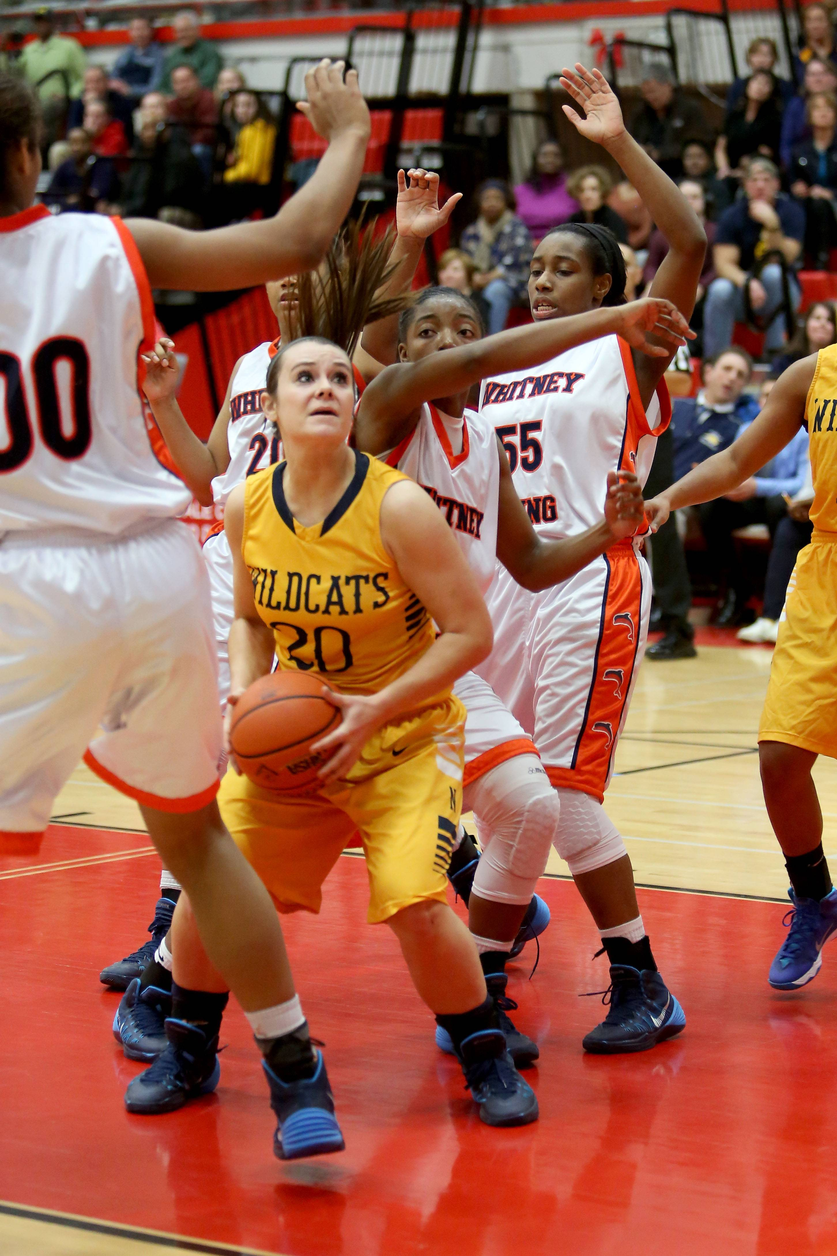 Neuqua Valley's Niki Lazar looks for room to shoot against Whitney Young.