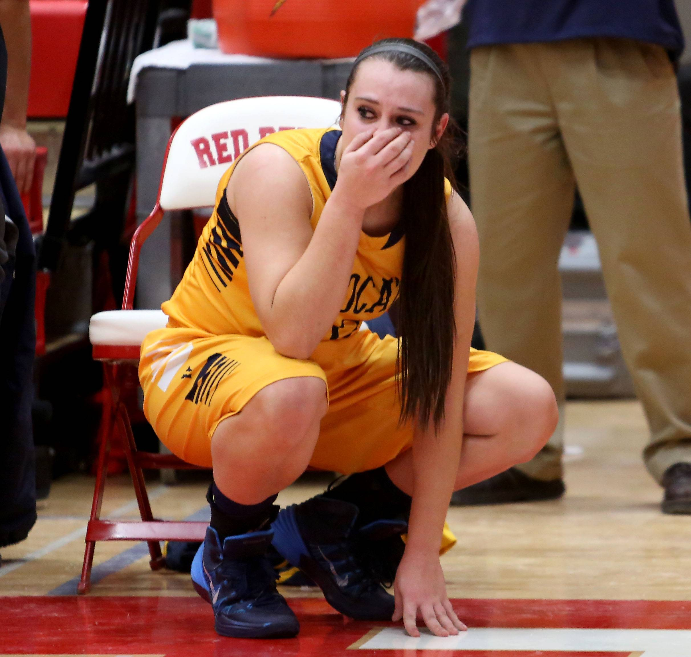 Neuqua Valley's Niki Lazar reacts after the game.