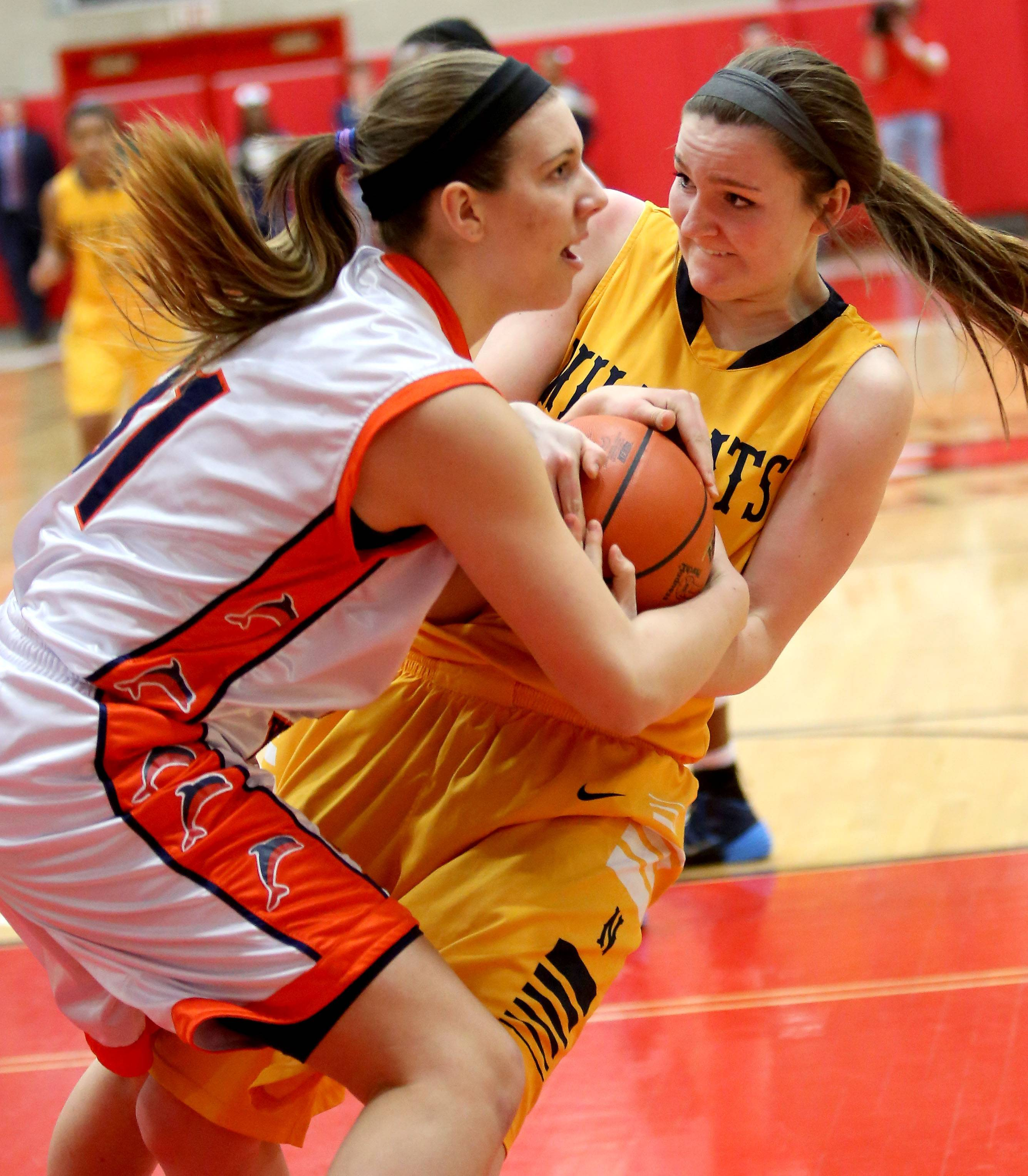 Neuqua Valley's Jamie McInereney, right, fights for the ball with Isabelle Spingola of Whitney Young.