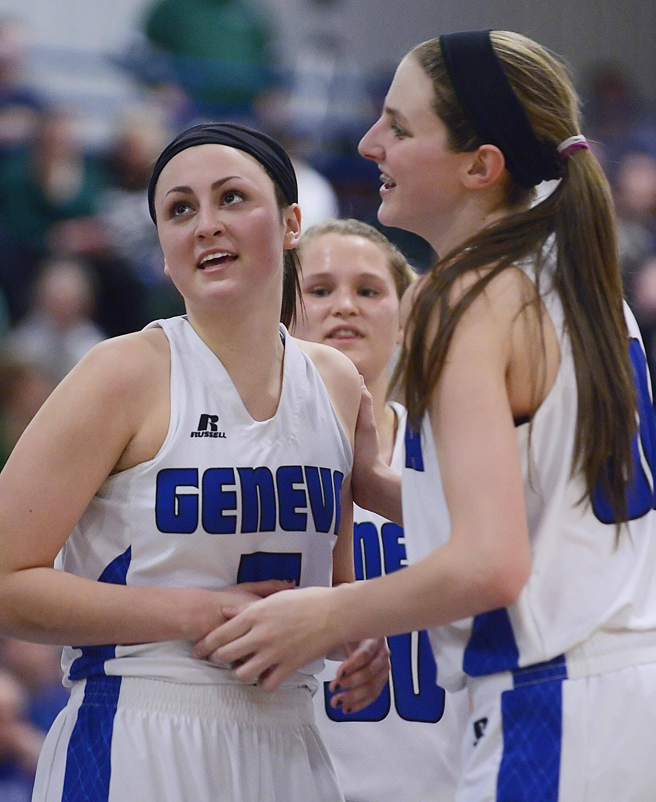 Geneva's Abby Novak, left, Grace Loberg, and Janie McCloughan, background, start to relax with a minute left in the game.